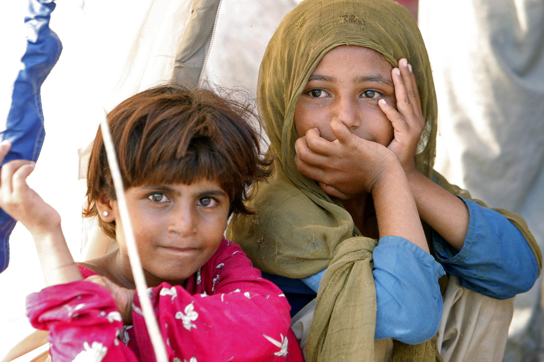 A portrait of two young girls in Sultan Colony, an encampment of people displaced by Pakistan's potent monsoon floods, in Punjab Province, near the city of Multan