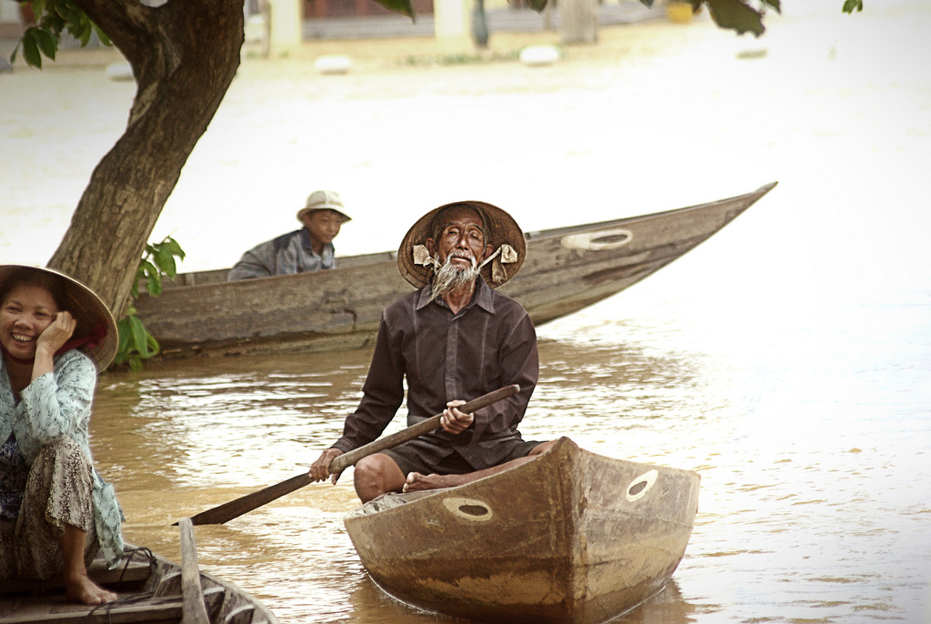 Old man on a boat after flooding in Hoi An, central Vietnam