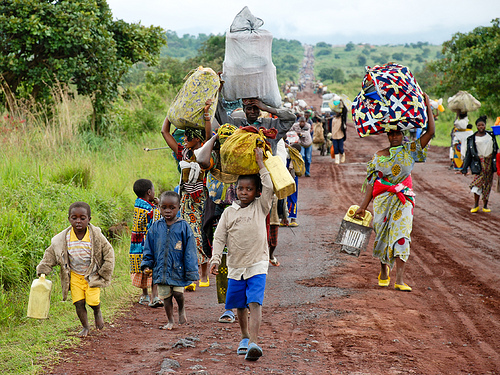 In the Eastern Democratic Republic of Congo, thousands of internally displaced people walk along the main road from Rumang'abo to Goma, fleeing the Kibumba region where fighting is ongoing