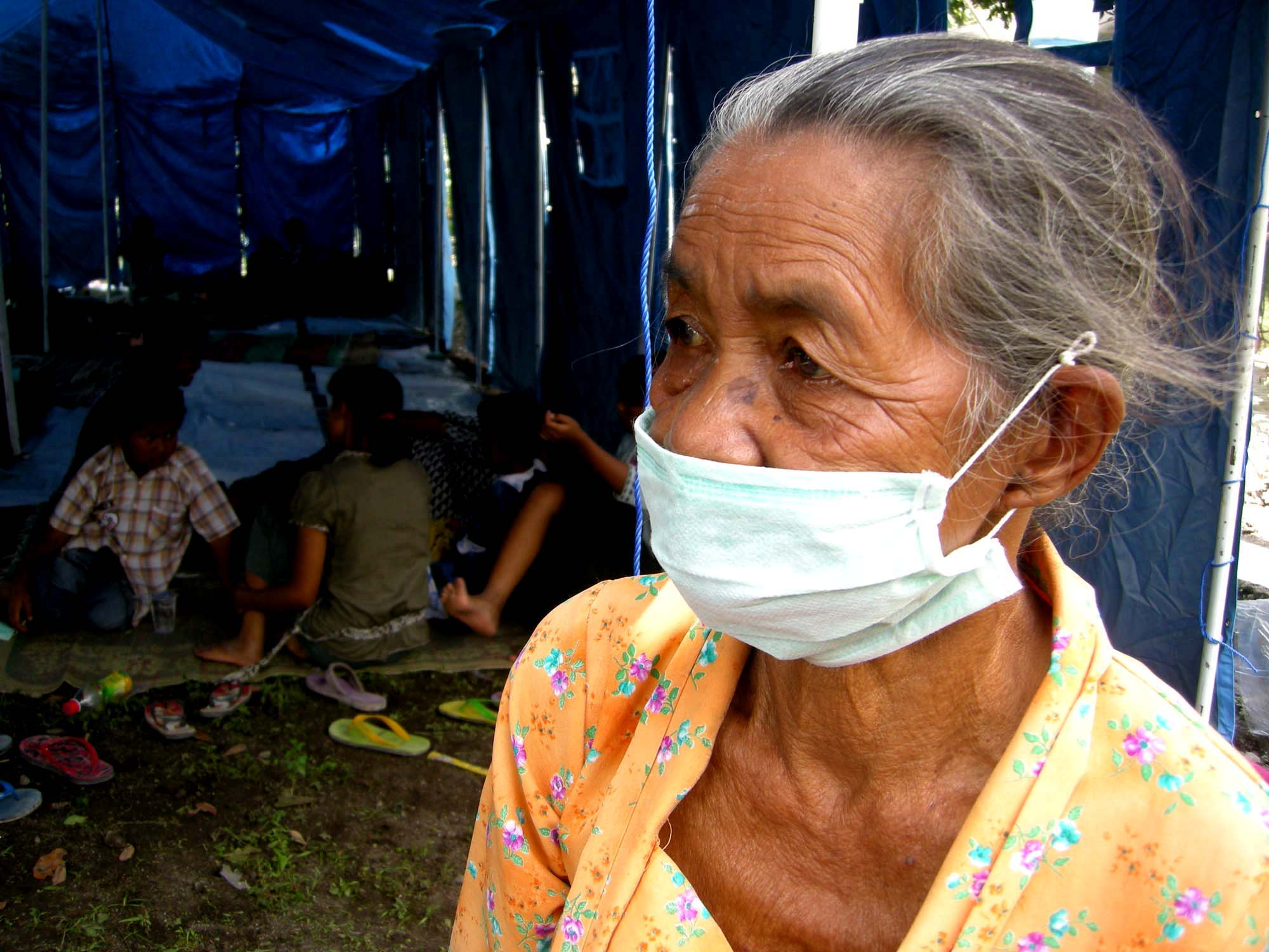 An elderly woman awaits assistance at an evacuation centre for those displaced by the Mount Merapi volcano in central Java. 27 October, 2010