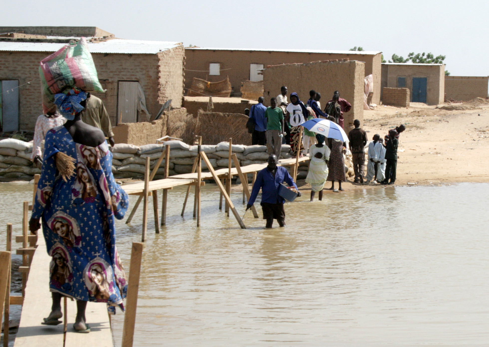 Residents of Walia wade or use makeshift bridges to get around