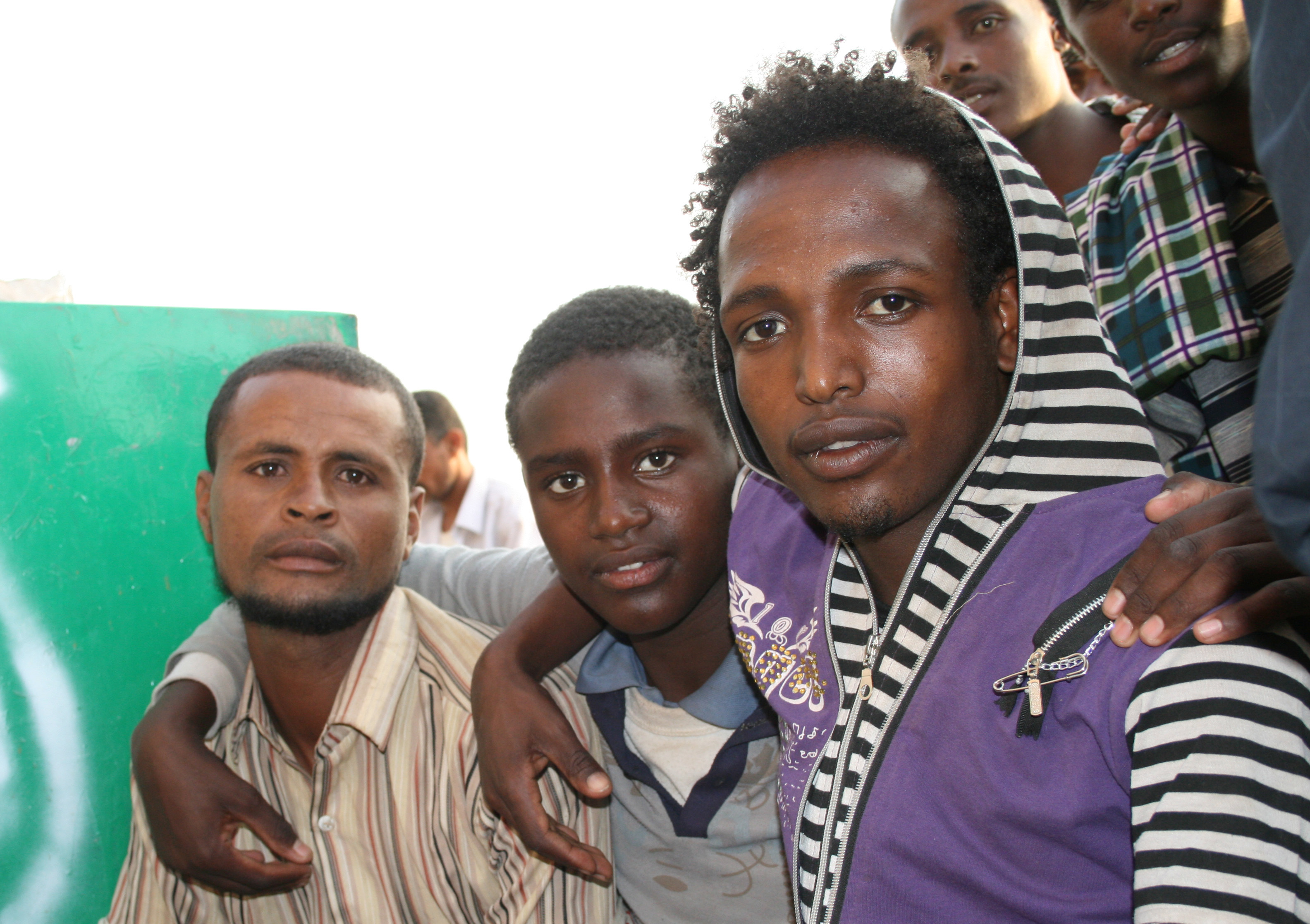 Ethiopians migrants sitting outside the offices of the Charitable Society for Social Welfare in Haradh, Yemen