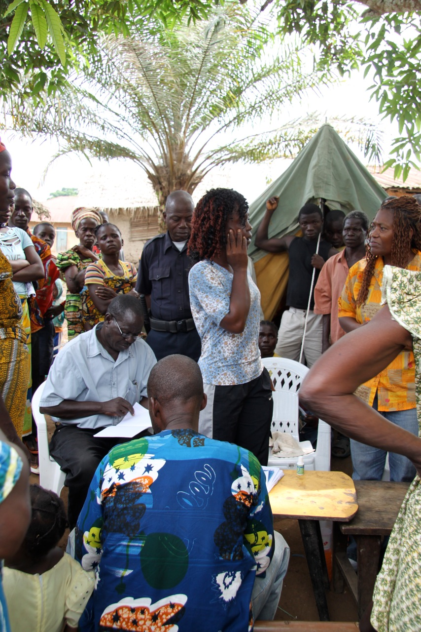UN Refugee Agency workers register Ivoirians who had fled to Liberia. Kissiplay, Nimba County, December 2010