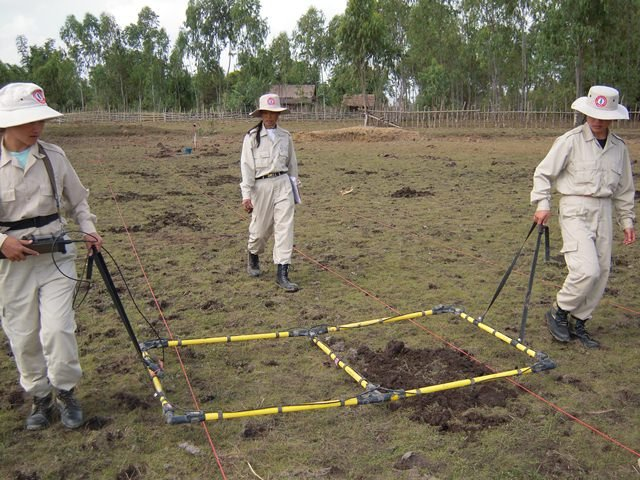 Women with UXO Lao searching for unexploded ordnance in Xiengkhuang Province in Laos, one of the few countries with all-female demining teams