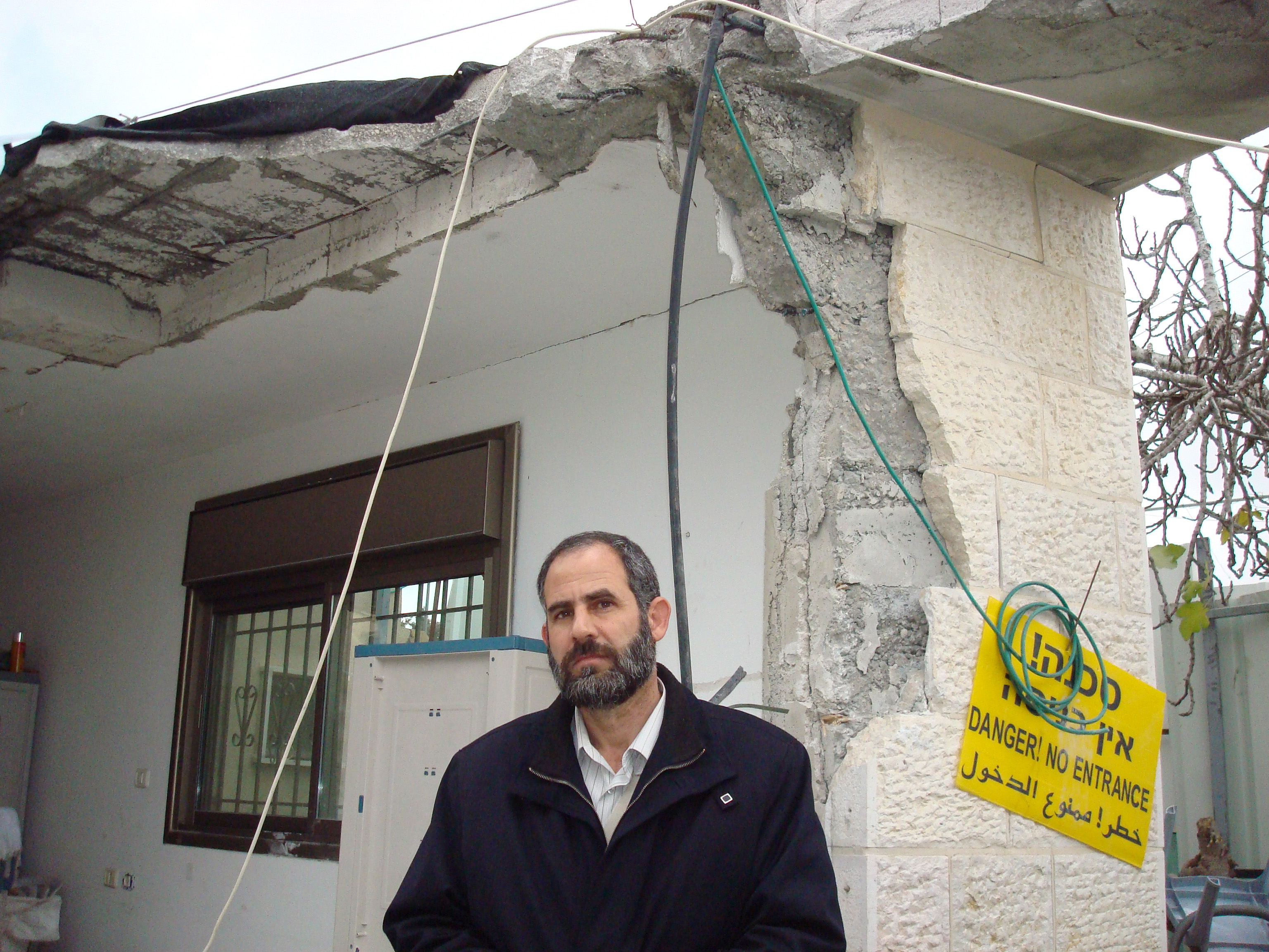 Nasser Siam stands beside the remnants of his family home after Israeli police and authorities from the Jerusalem municipality demolished their home in Sheikh Jerrah, East Jerusalem