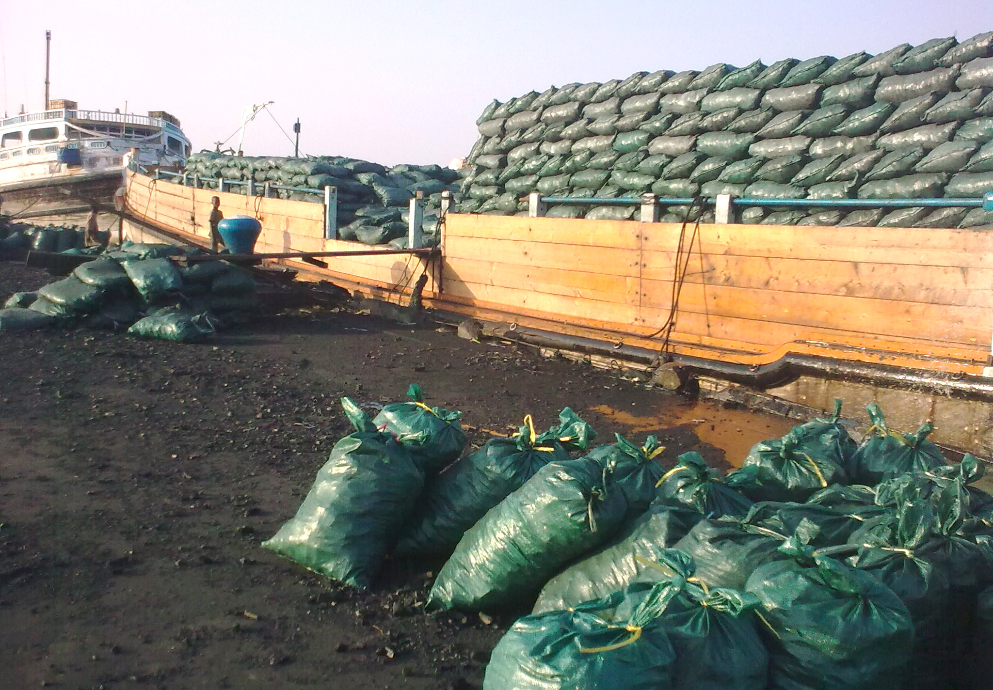 Charcoal being loaded on to a ship in the southern port city of Kismayo, Somalia. The charcoal trade is booming amid severe drought in Somalia