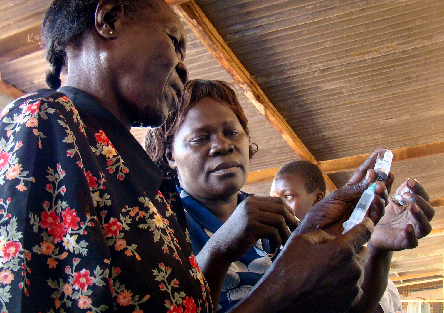 Nurses preparing vaccine vial in one of the vaccination outpost in Kitgum district