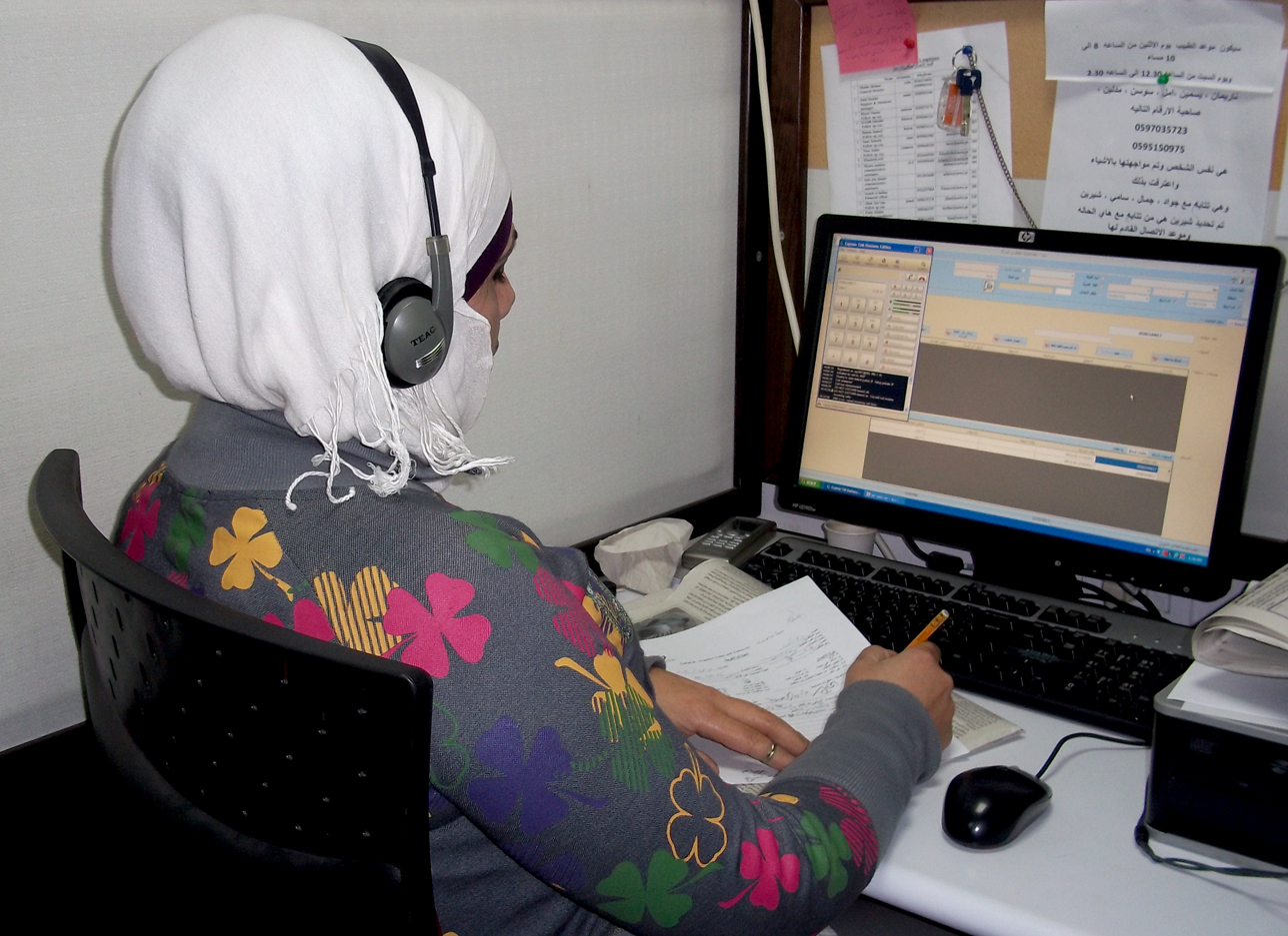 A social worker at Palestinian NGO, Sawa, fields calls from victims of domestic violence. Calls to the helpline are confidential and free from a Palestinian cellular phone
