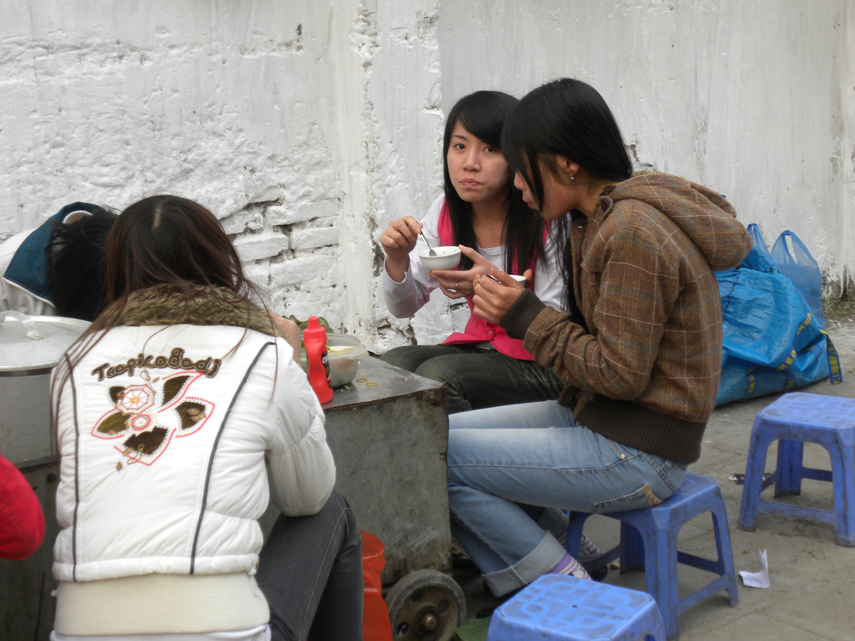 A group of young girls gather in Hanoi. Scores of young women are lured by prospects of better paying jobs abroad