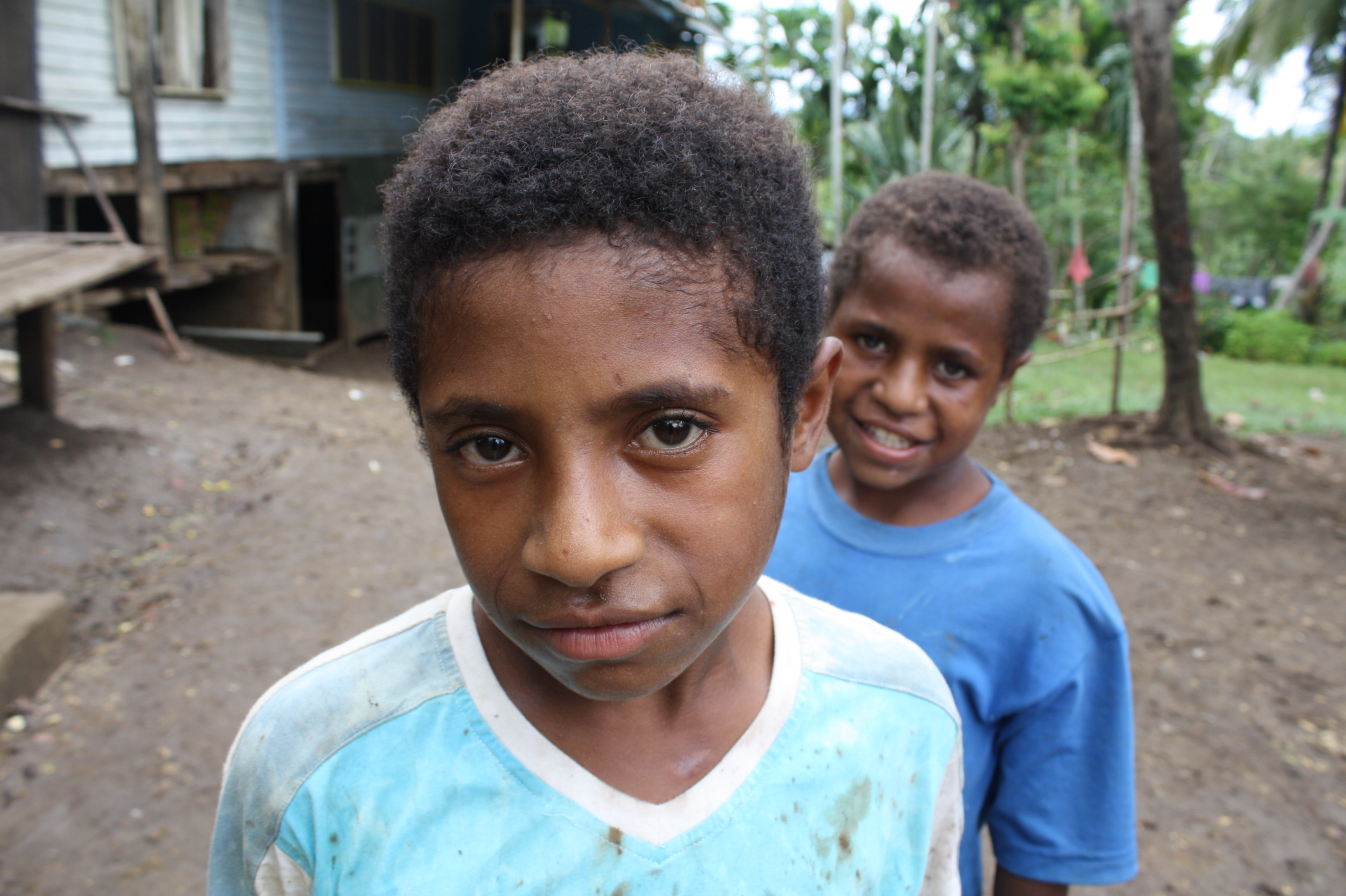 Two boys look to the camera in Madang Province, northern PNG
