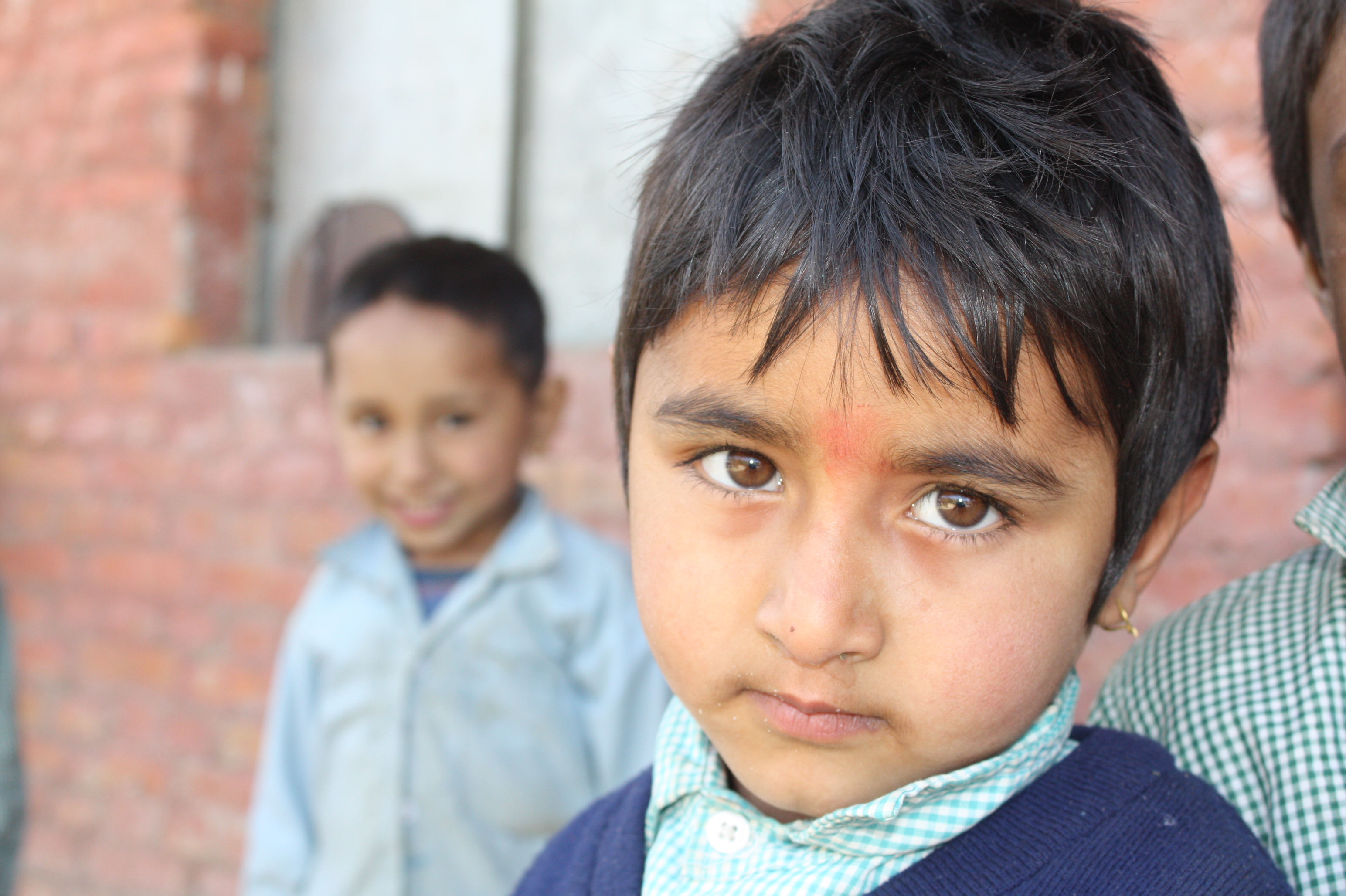 A young schoolboy in Bhaktapur District. Literacy remains a challenge in the mountain nation