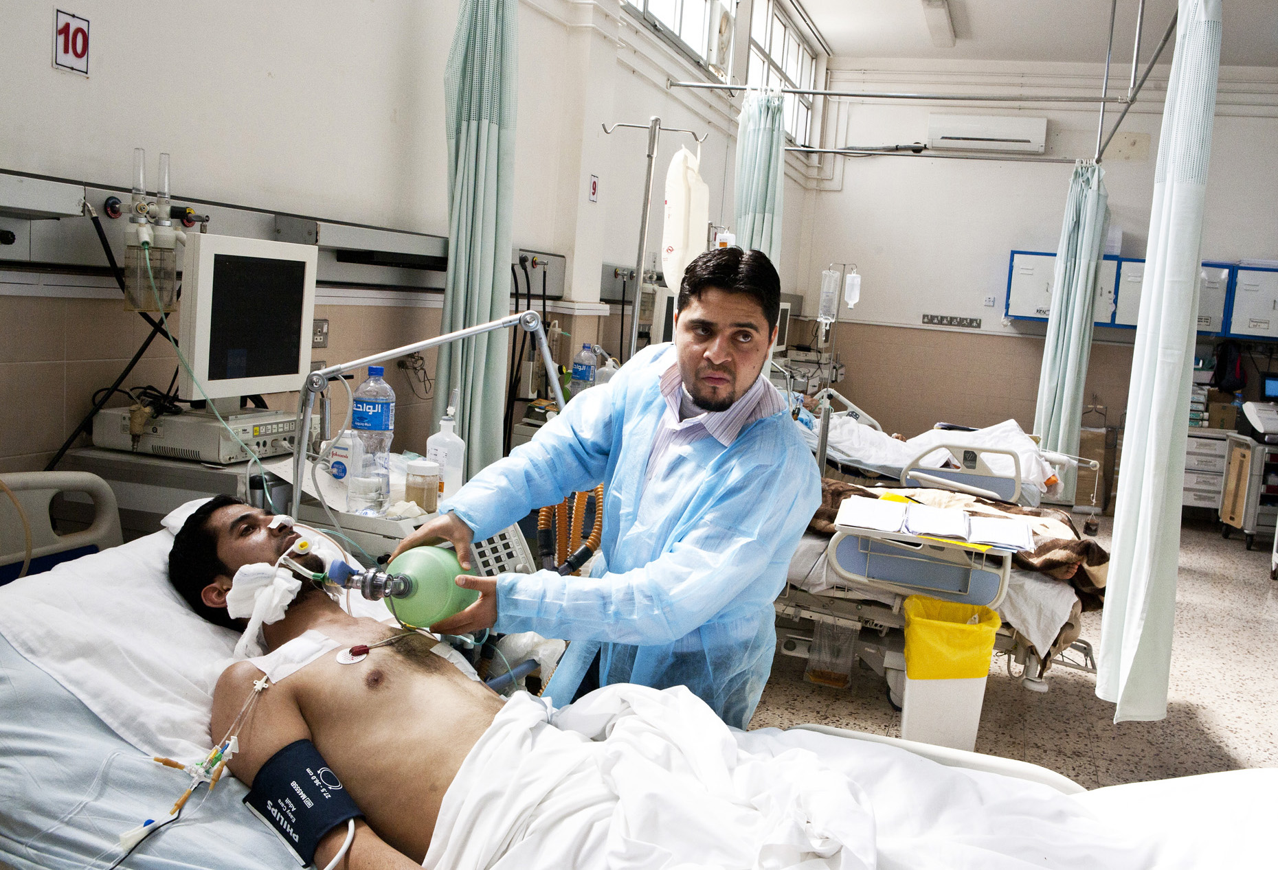 Aljalaa Hospital, Benghazi. A patient in the trauma section receives care from a Libyan doctor. Feb 2011