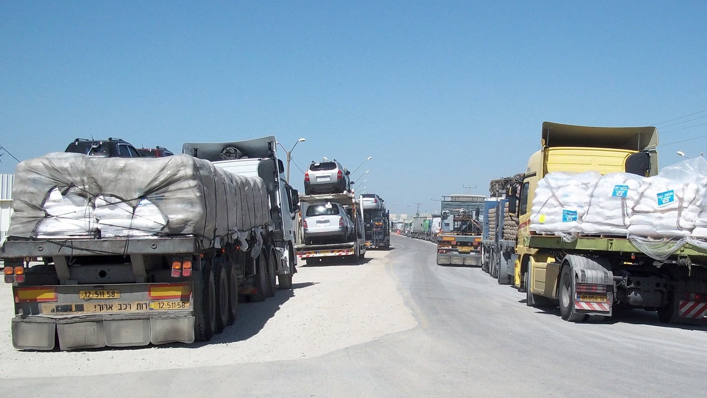 Truckloads of humanitarian aid and commercial goods bottle-necked at at Kerem Shalom crossing along the Gaza-Israel border