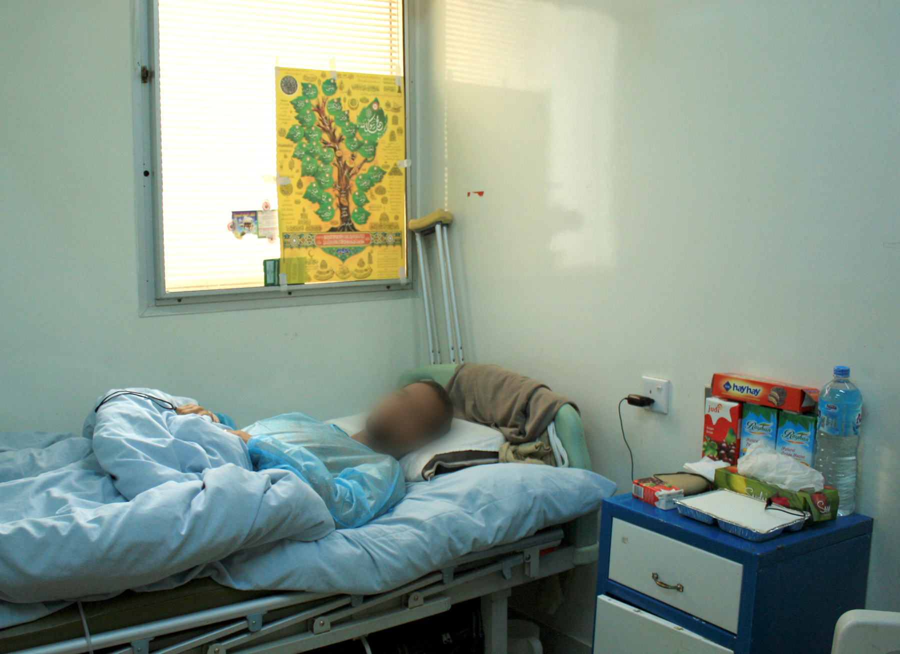 An injured man waits to be operated on in a Benghazi hospital. He was shot by pro-Gaddafi forces while fighting on the frontline at the beginning of March
