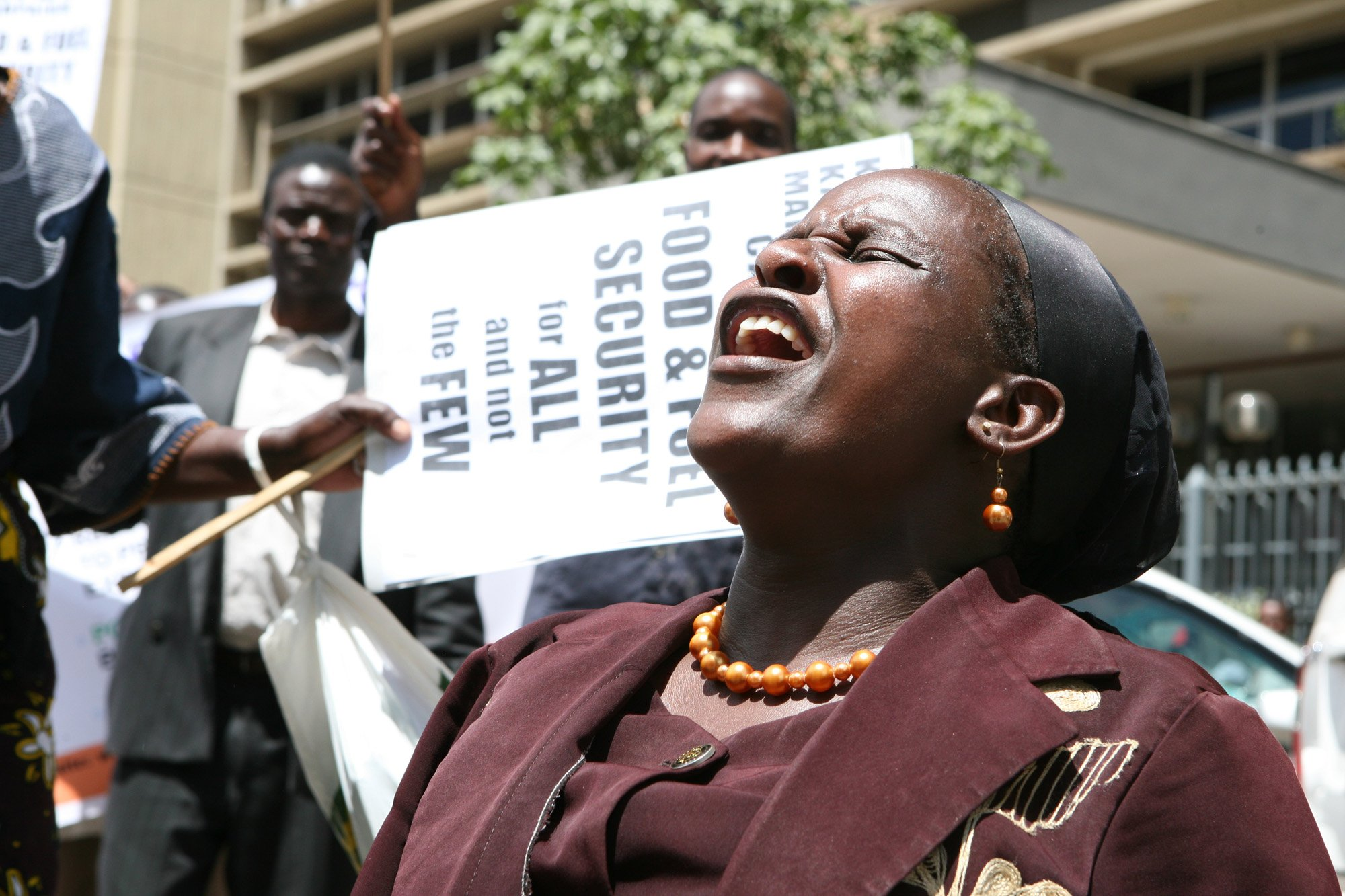 A woman joins fellow protestors in demonstrations to pressure the Kenya government to take action against rising fuel prices. Rising fuel prices have had severe impacts on low-income earners