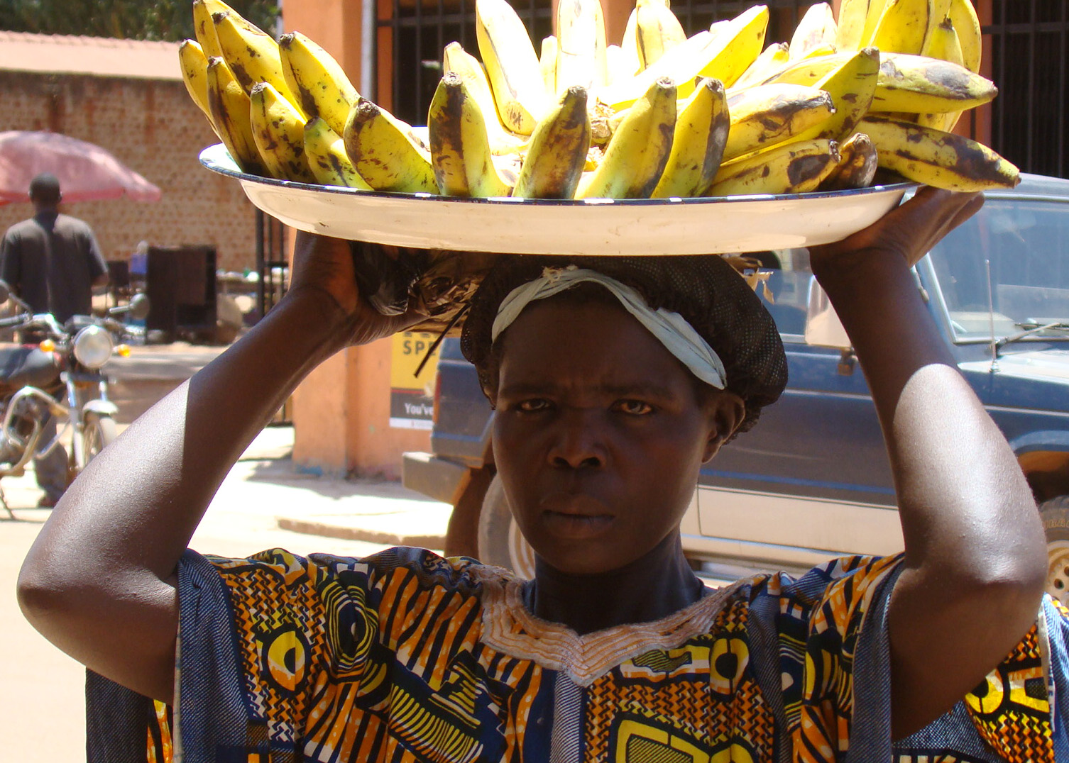Slum dweller Christine Amony hawks bananas in Gulu town, northern Uganda