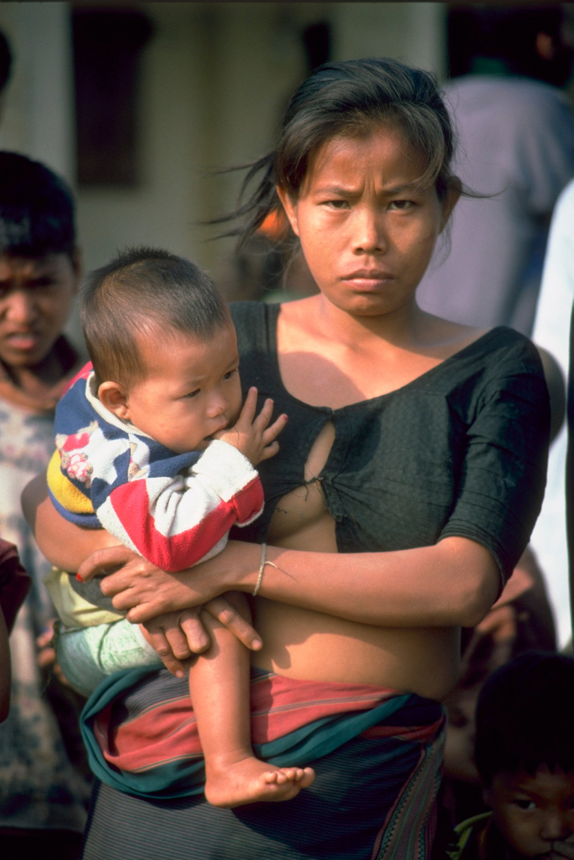 A young woman with her child in Bangladesh's Chittagong Hill Tracts. Land continues to be stolen from the Jumma tribal people by both the army, and by settlers who are supported by the government, say activists
