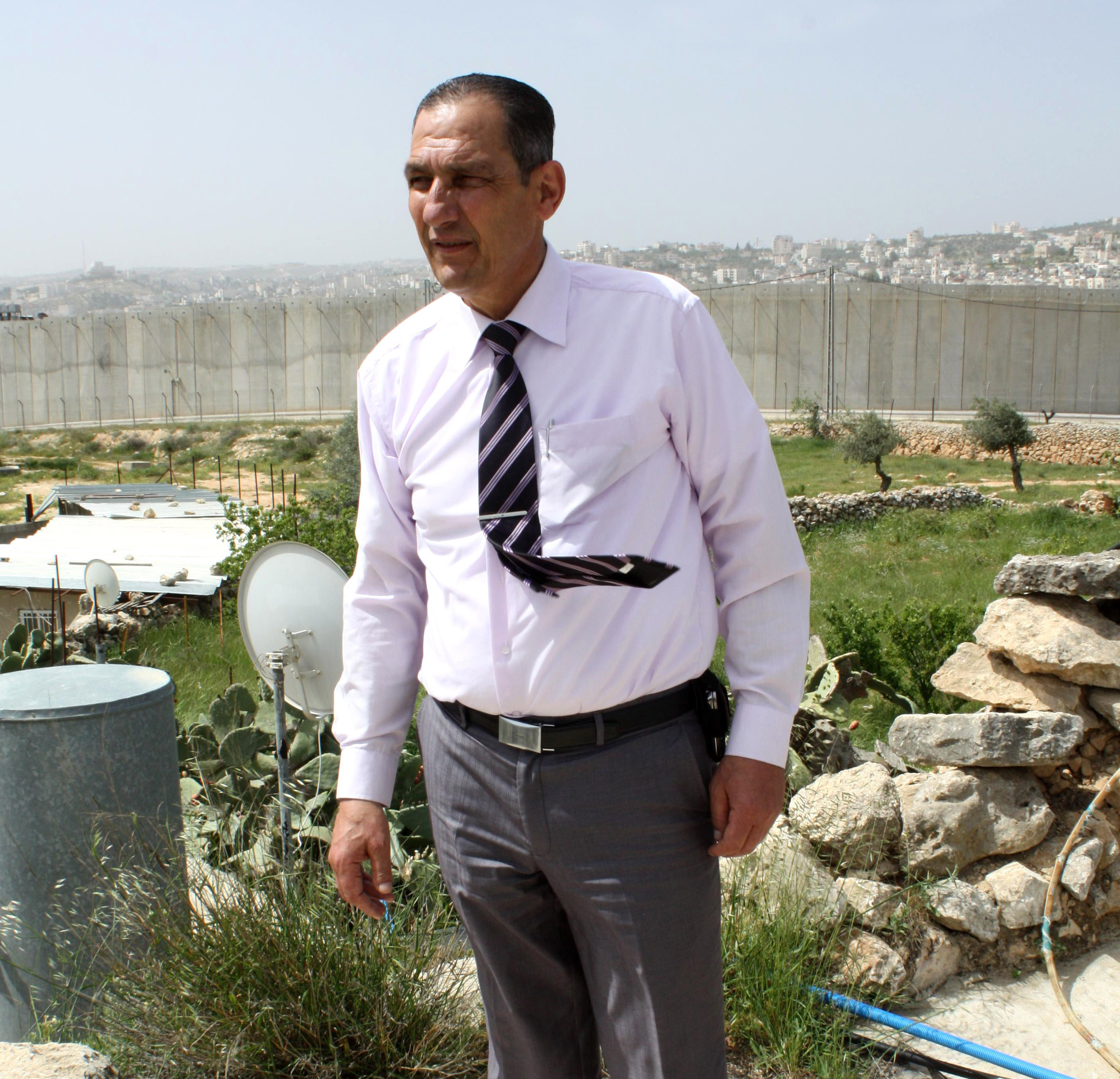 Fuad Ahmed Jado stands in front of his house in Tantour, East Jerusalem, where 80 residents have been cut off from hospitals in the West Bank by the Separation Wall
