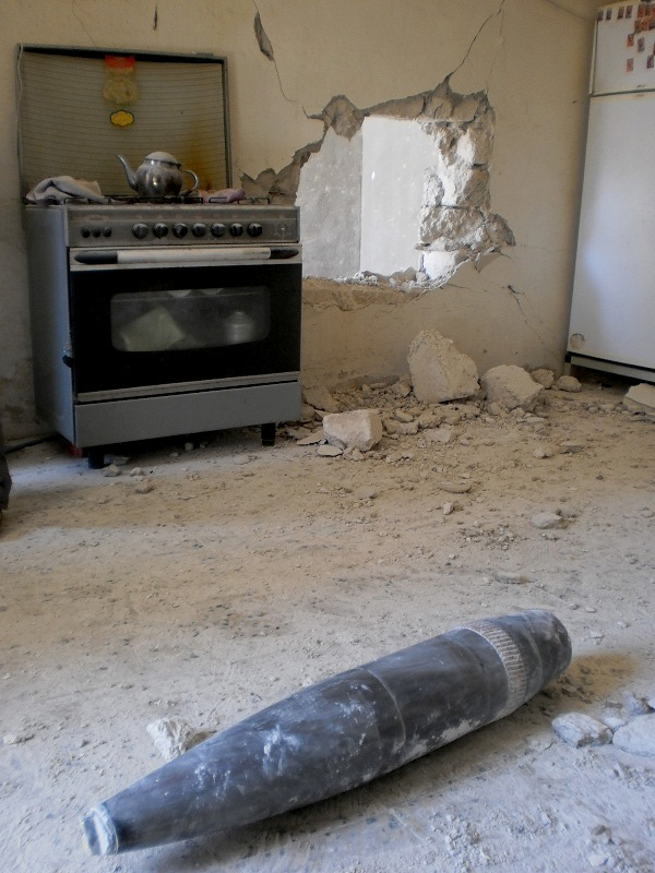 An UXO in a kitchen floor in a damaged apartment in Adjabiya, Libya