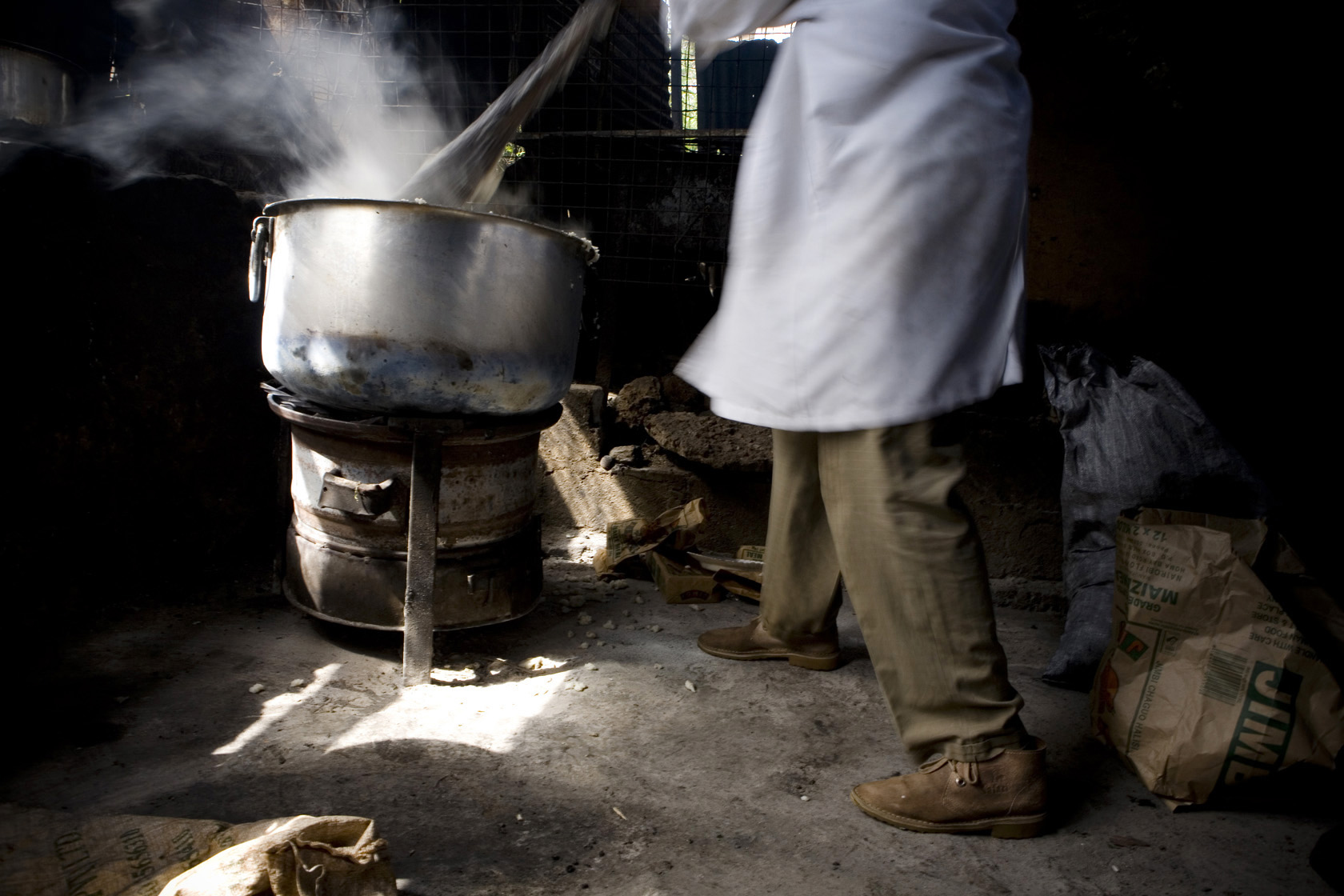 A cook on the job at a restaurant at the Nairobi City Park market, Kenya