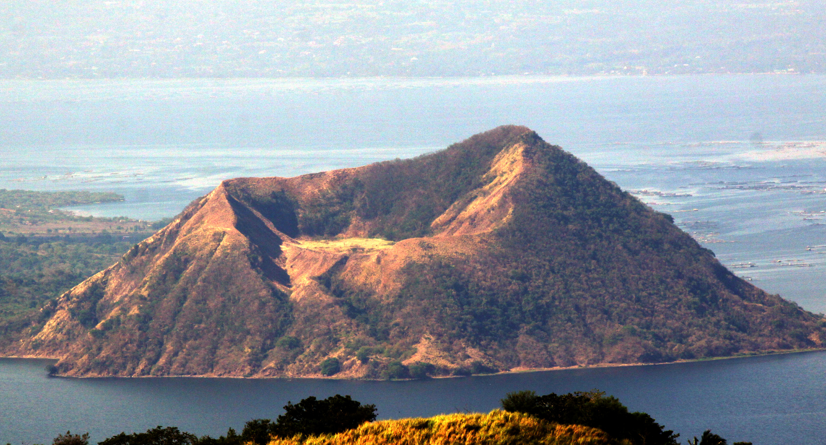 A top shot of one of Taal Volcano's several craters called the Binintiang Laki. Villagers who had lived for generations on Taal Volcano, one of the most dangerous among the country's 23 active peaks, have refused to abandon the area, despite warnings of a