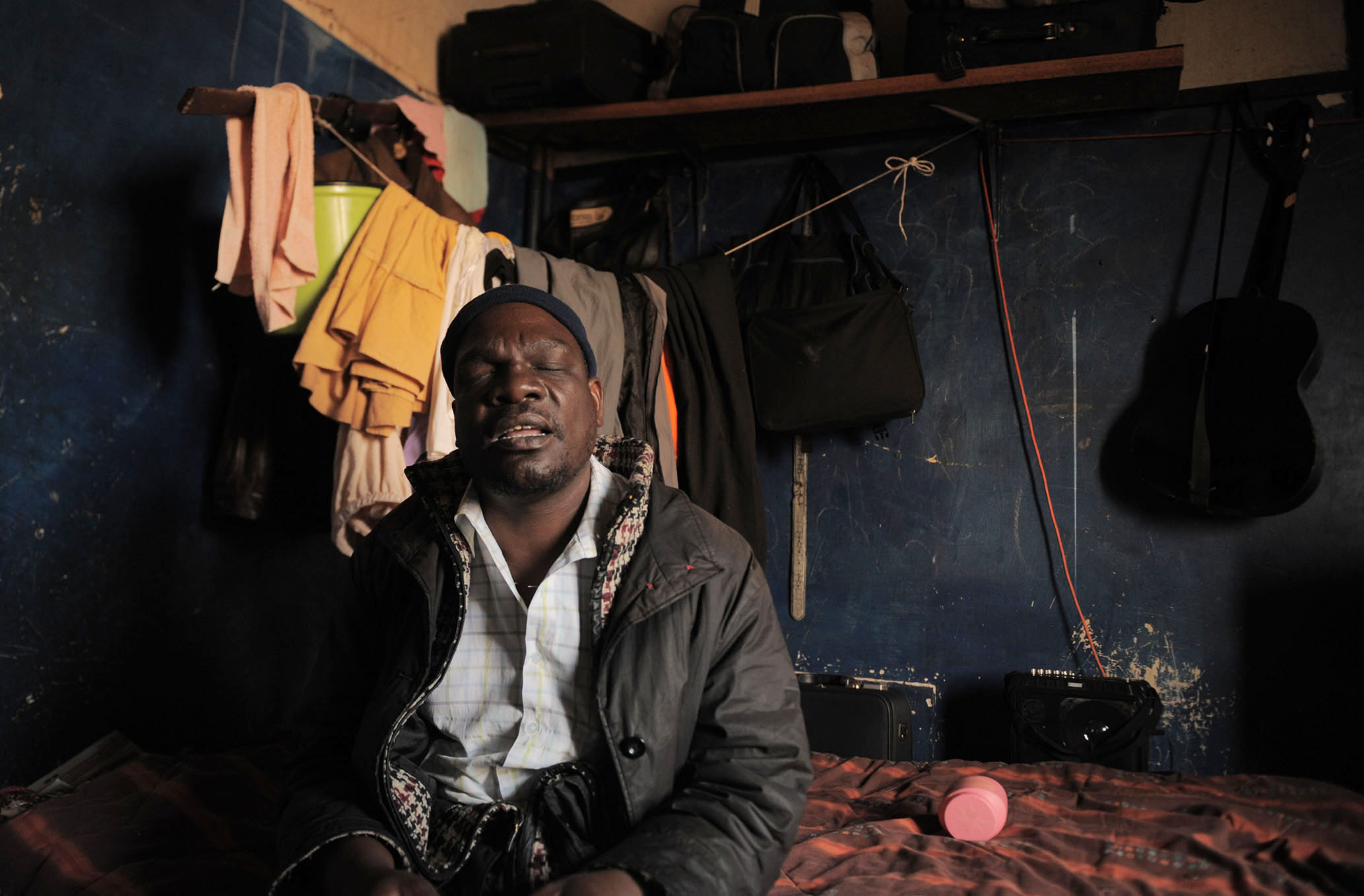 Samuel Mokwena, a blind beggar, in his room at an abandoned building in Johannesburg's inner city