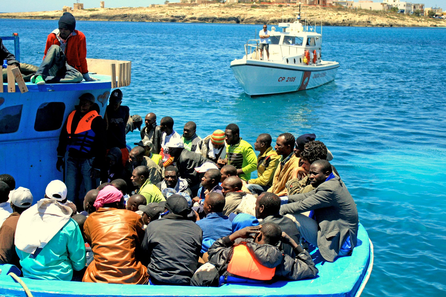 A boat carrying sub-Saharan African migrant workers arrives in Lampedusa from Tripoli