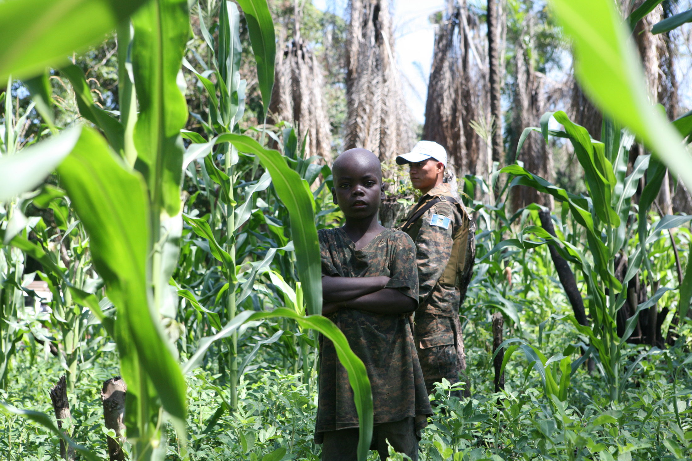 A UN Monusco peacekeeper in Dungu, Oriental Province, keeps watch over Linakofo, a camp of 1359 internally-displaced people (IDPs), all of whom have fled attacks by the Lord's Resistance Army (LRA)