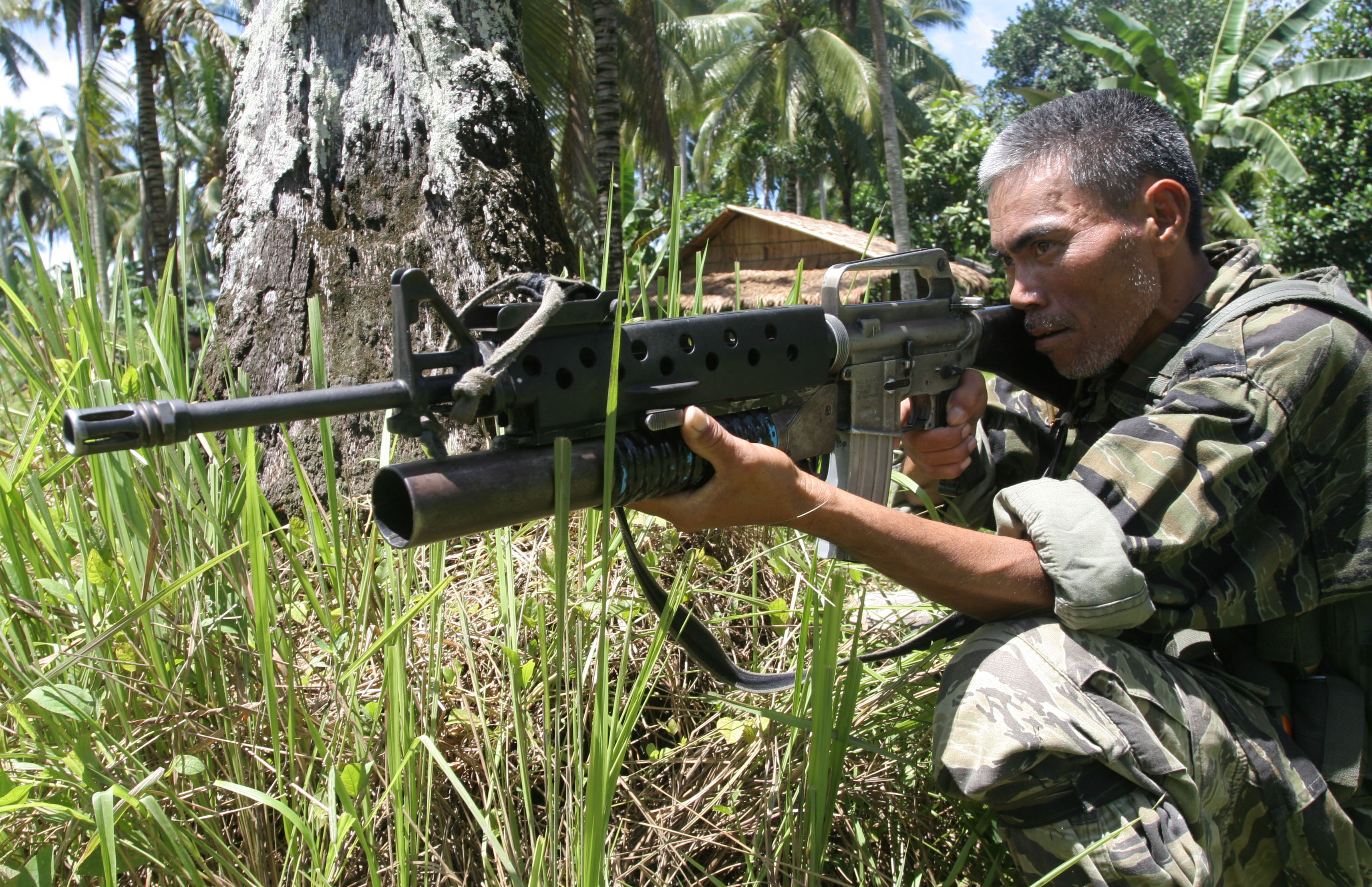 A Moro Islamic Liberation Front guerrilla guards a rebel encampment at Sultan Kudarat on the Philippine island of Mindanao