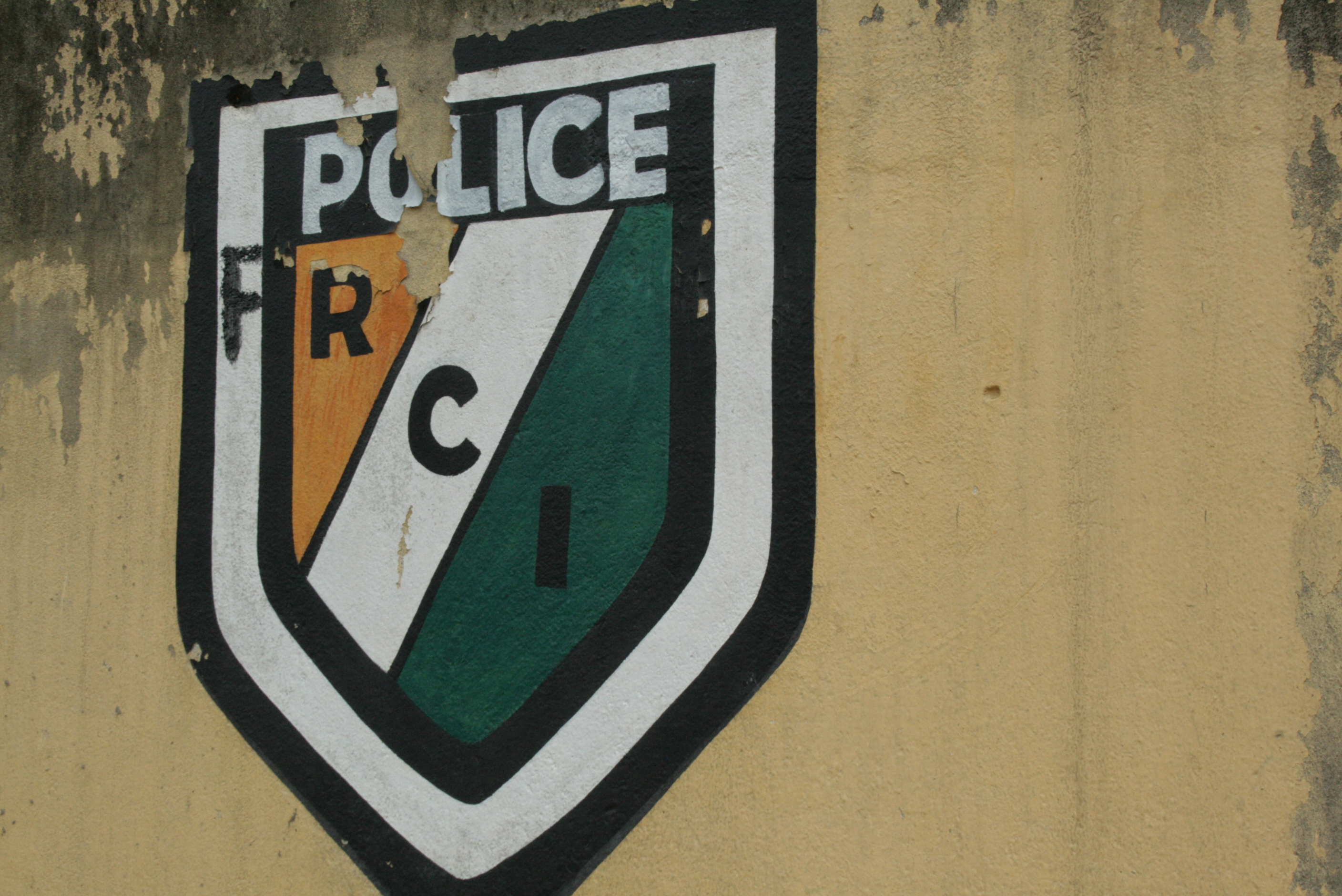 "Ivoirian national police emblem changed to spell ""FRCI"" - the name of the new military. Adjamé District of the commercial capital, Abidjan, Côte d'Ivoire July 2011"