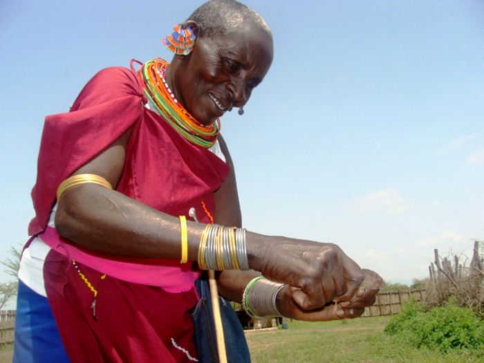 Nchoo Ngochila, a reformed mutilator, demonstrates how she used to cut girls