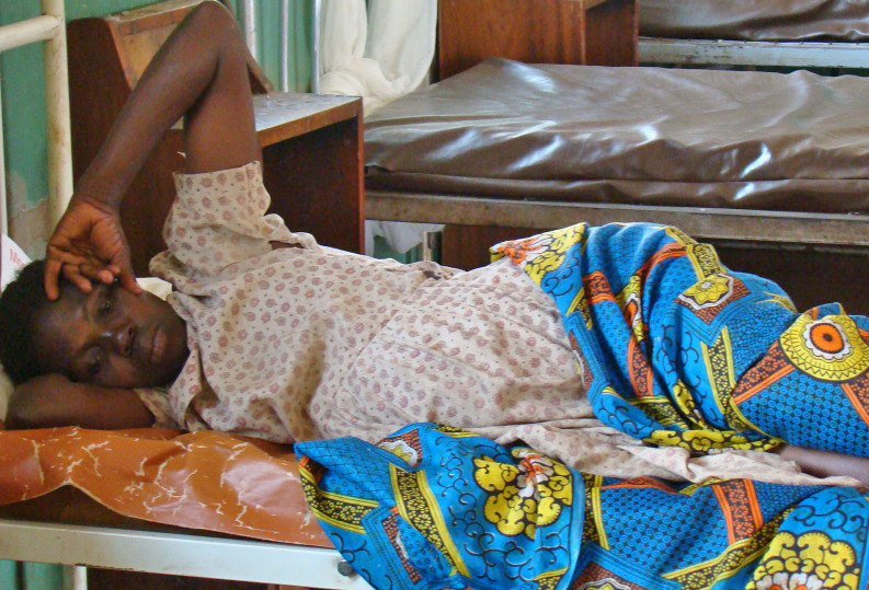 A mother awaits treatment at a health centre in Gulu, northern Uganda