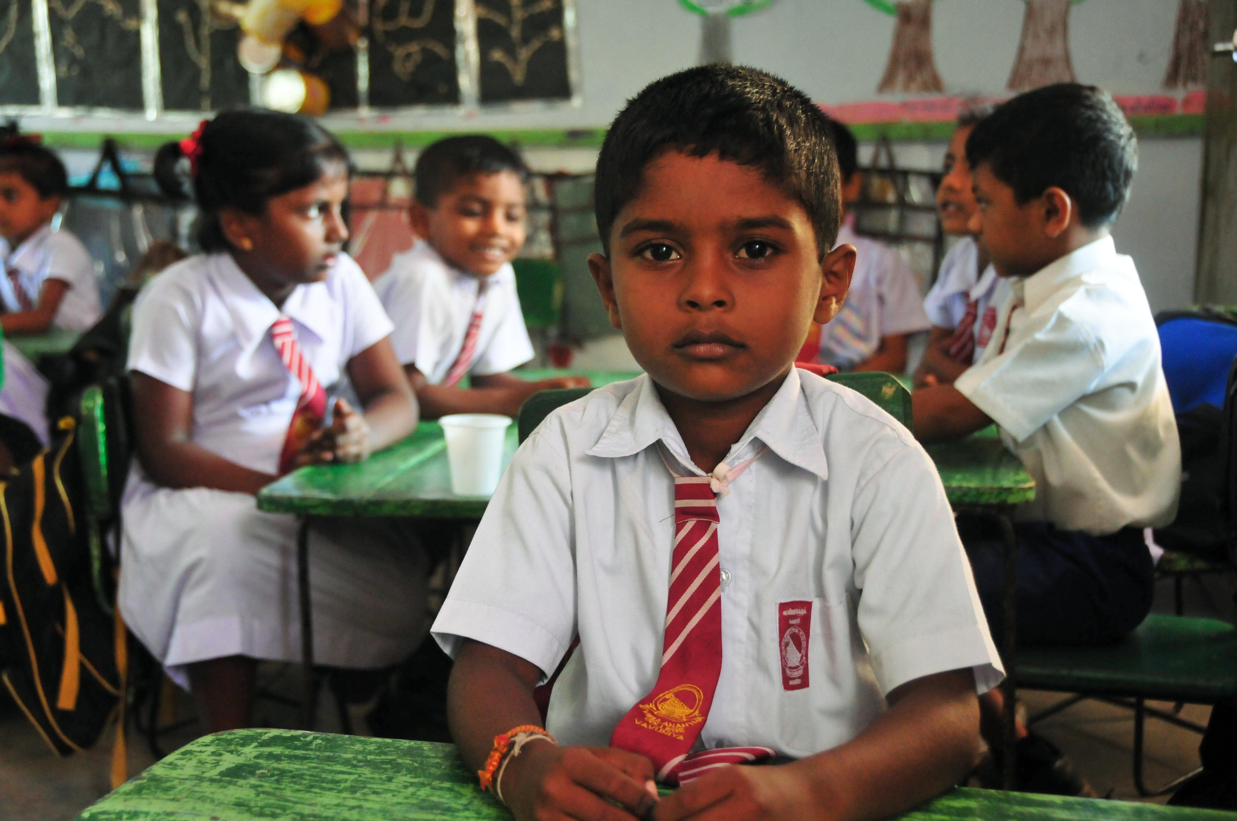 A young boys sits at his desk in northern Sri Lanka. Thousands of children have returned to the classroom since the conflict ended in May 2009