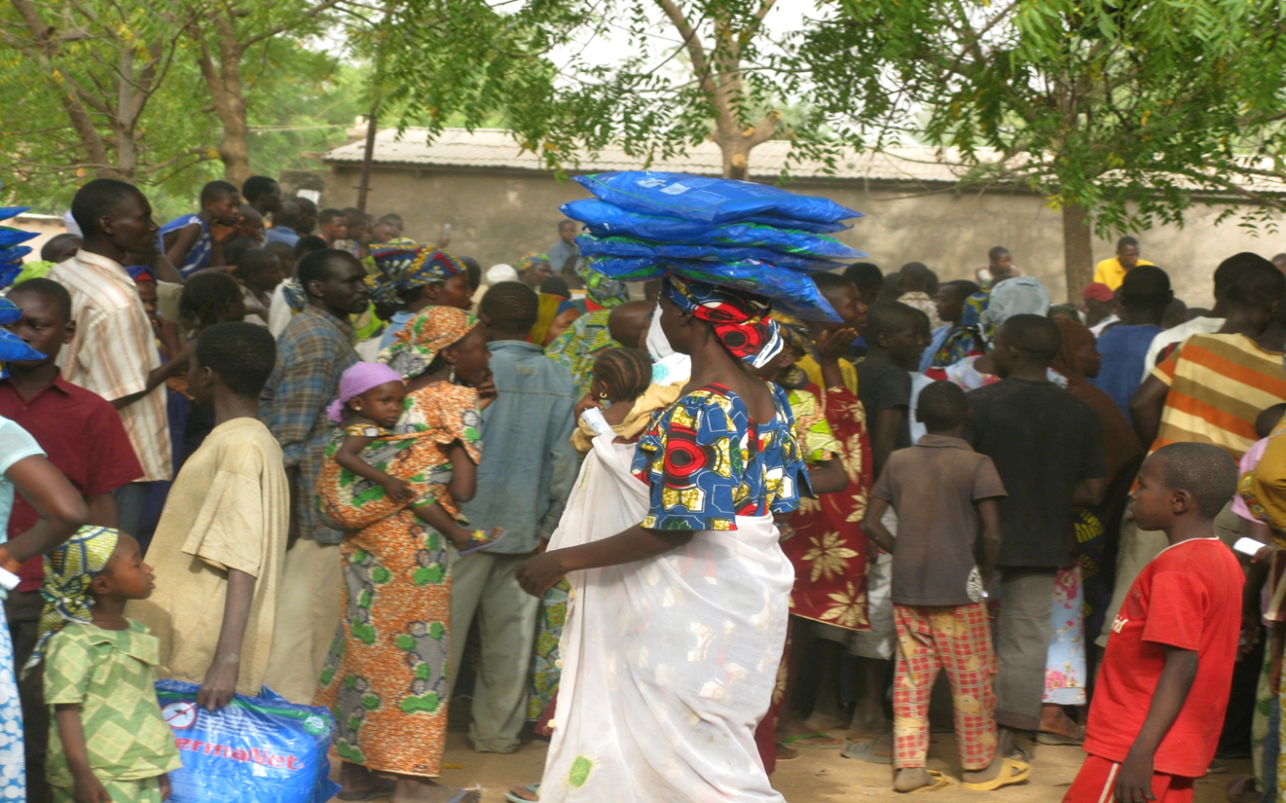 Families picking up insecticide-treated mosquito nets in northern Cameroon