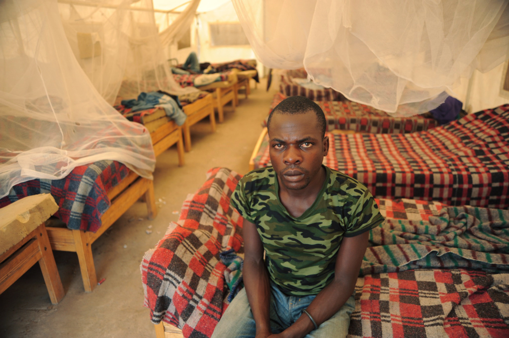 Mupira Baziralo, 25, in the sleeping quarters of MONUSCO's DDRRR facility. He was a combatant for the Mai-Mai Kifua-Fua for seven years