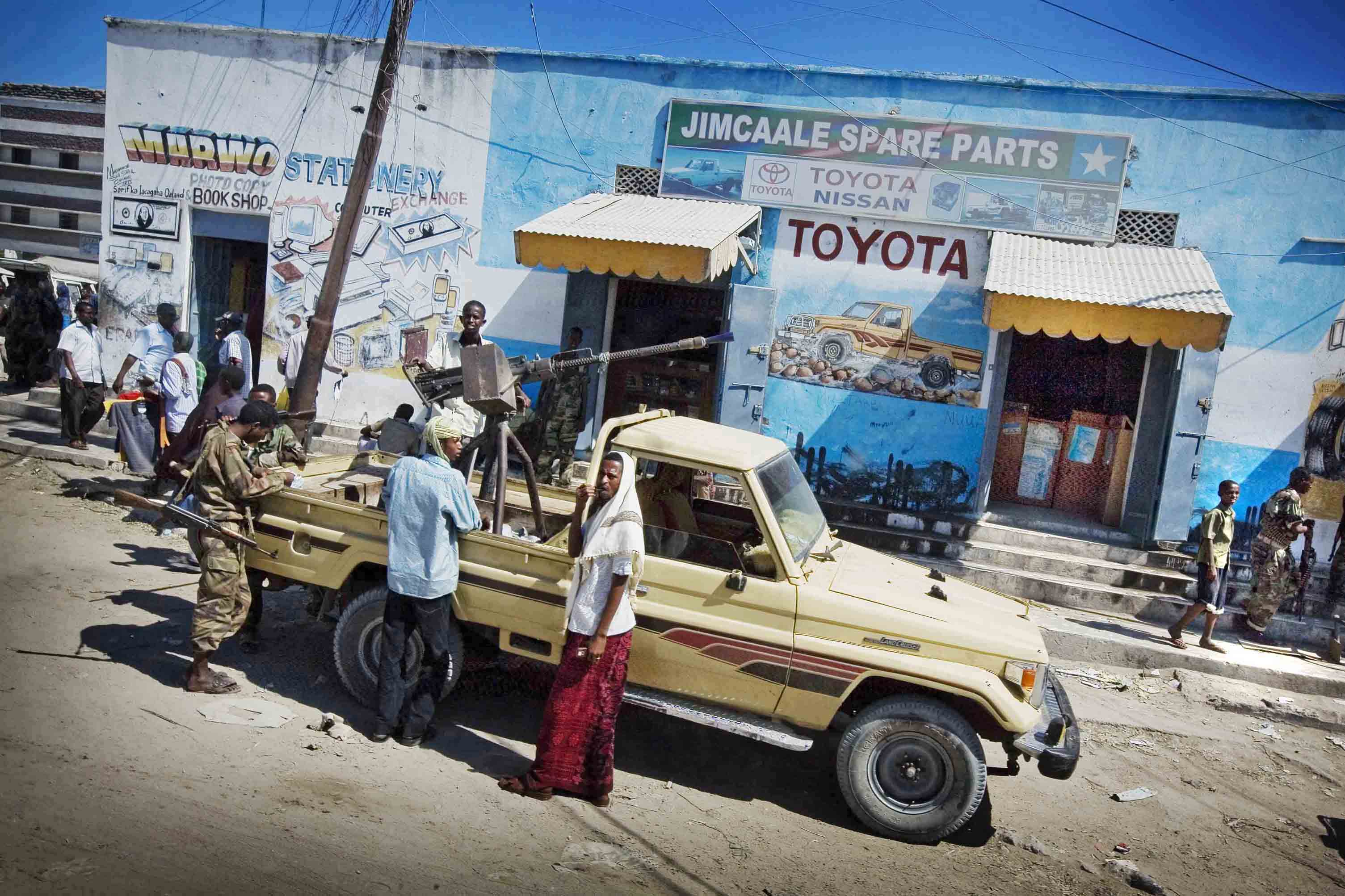 Armed groups stop outside a shop in Mogadishu, Somalia. December 2010