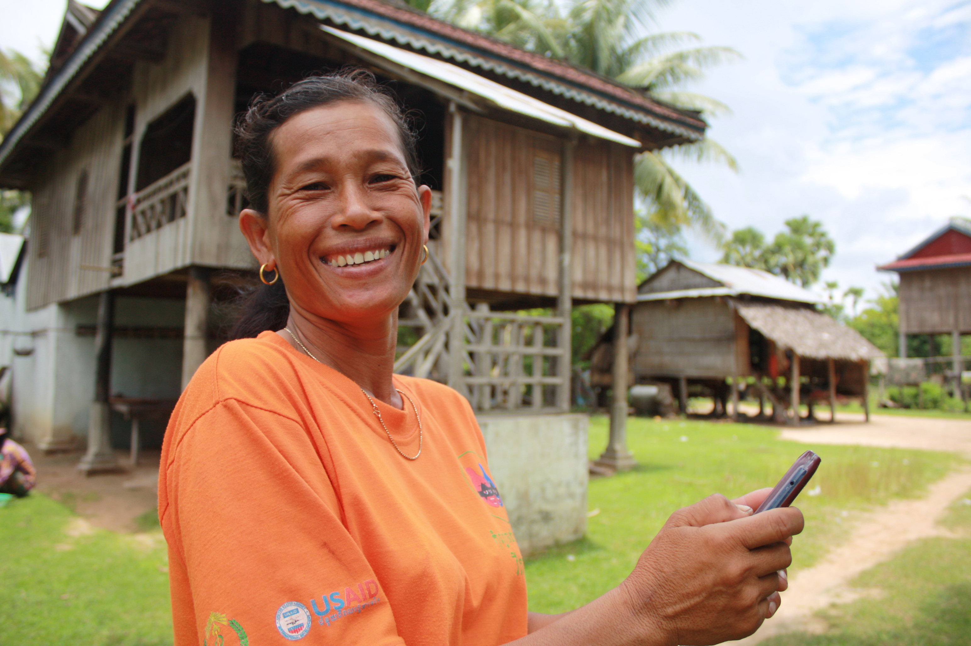 Armed with a mobile phone, Sophana Pich, 41, can now relay information to Cambodian health authorities faster. She is one of close to 3,000 village malaria workers working to contain the spread of malaria