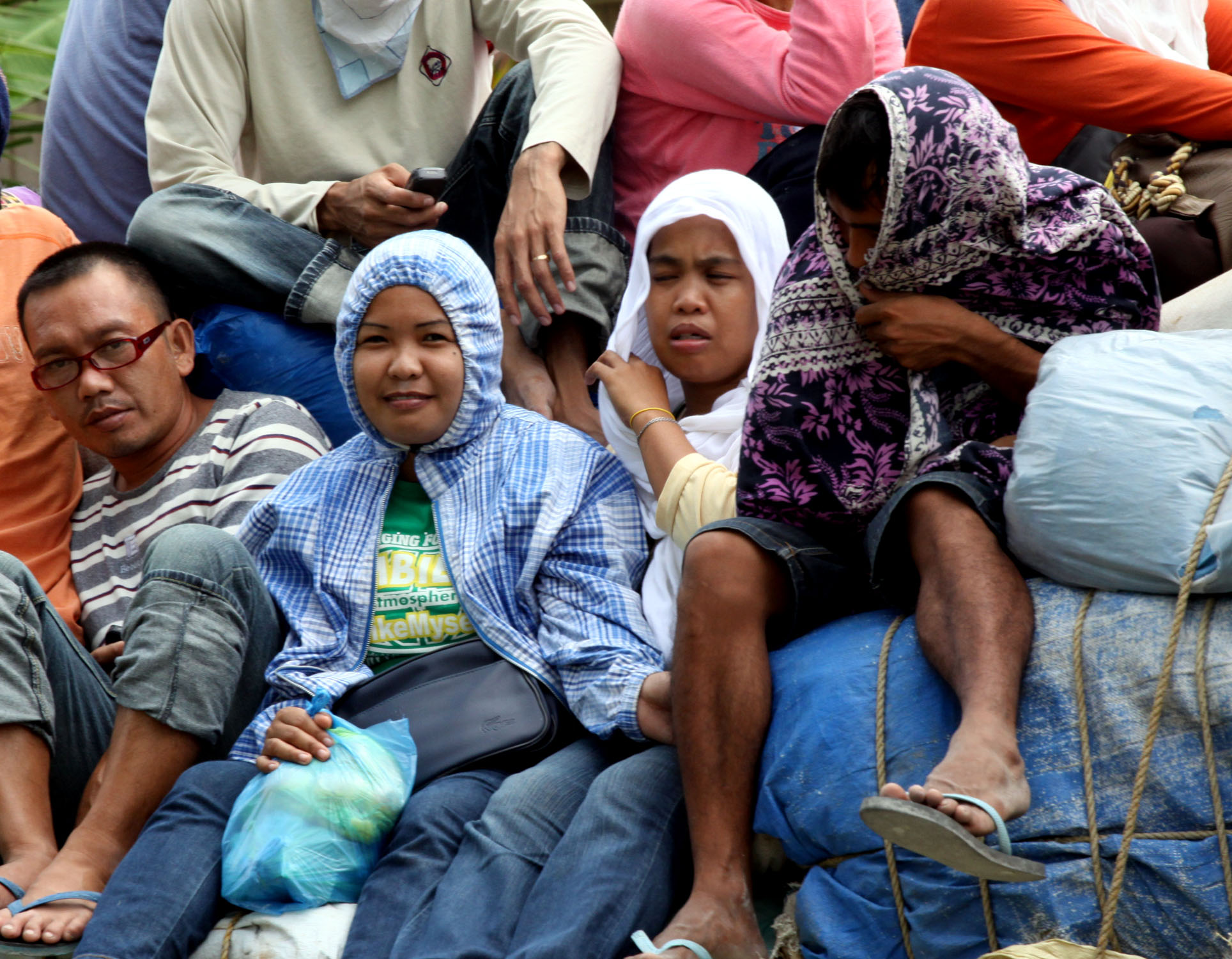 Villagers aboard a truck as they pass through tight security at a checkpoint on the southern island of Mindanao