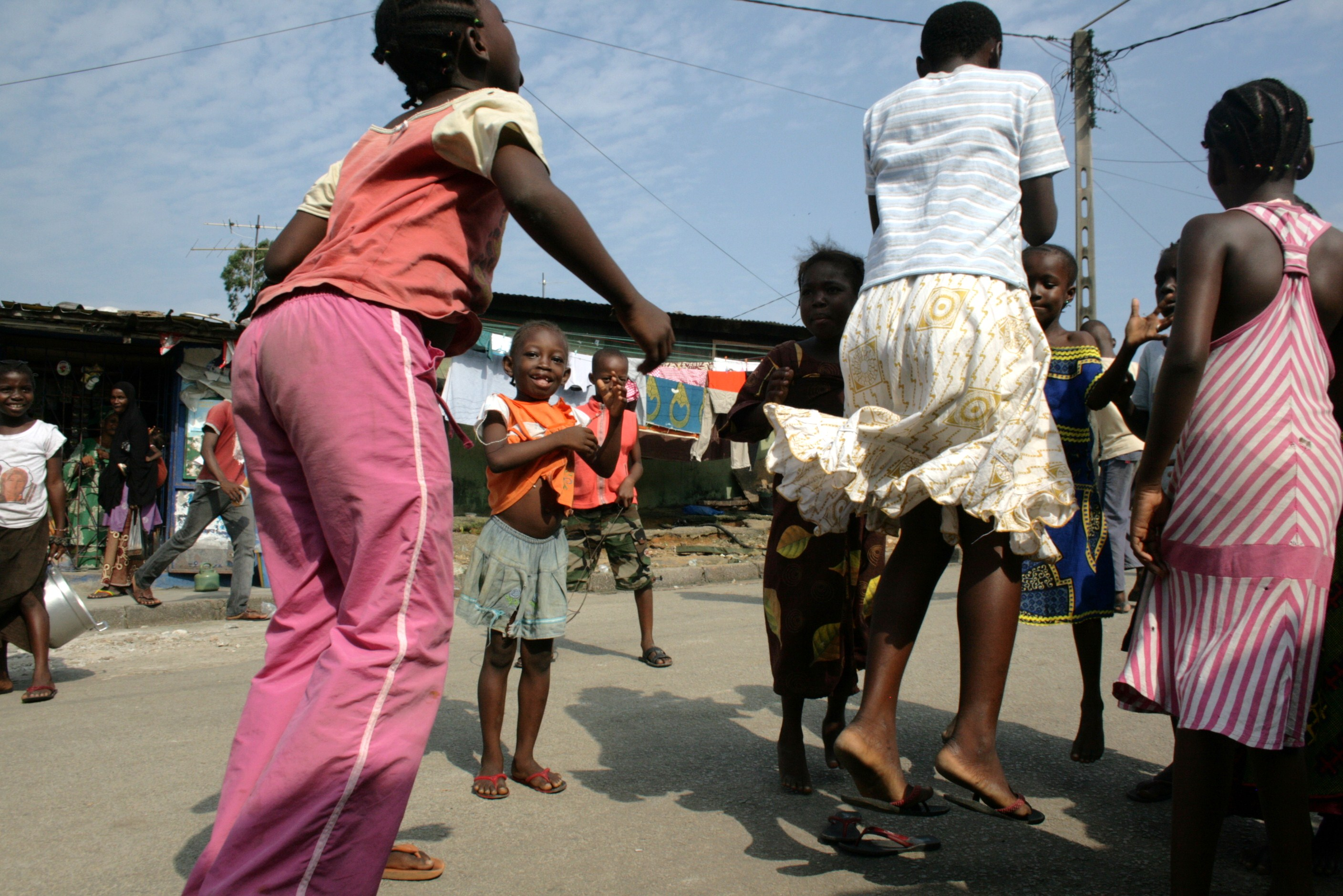 Girls playing in the Adjamé neighbourhood of Côte d'Ivoire's commercial capital, Abidjan. July 2011