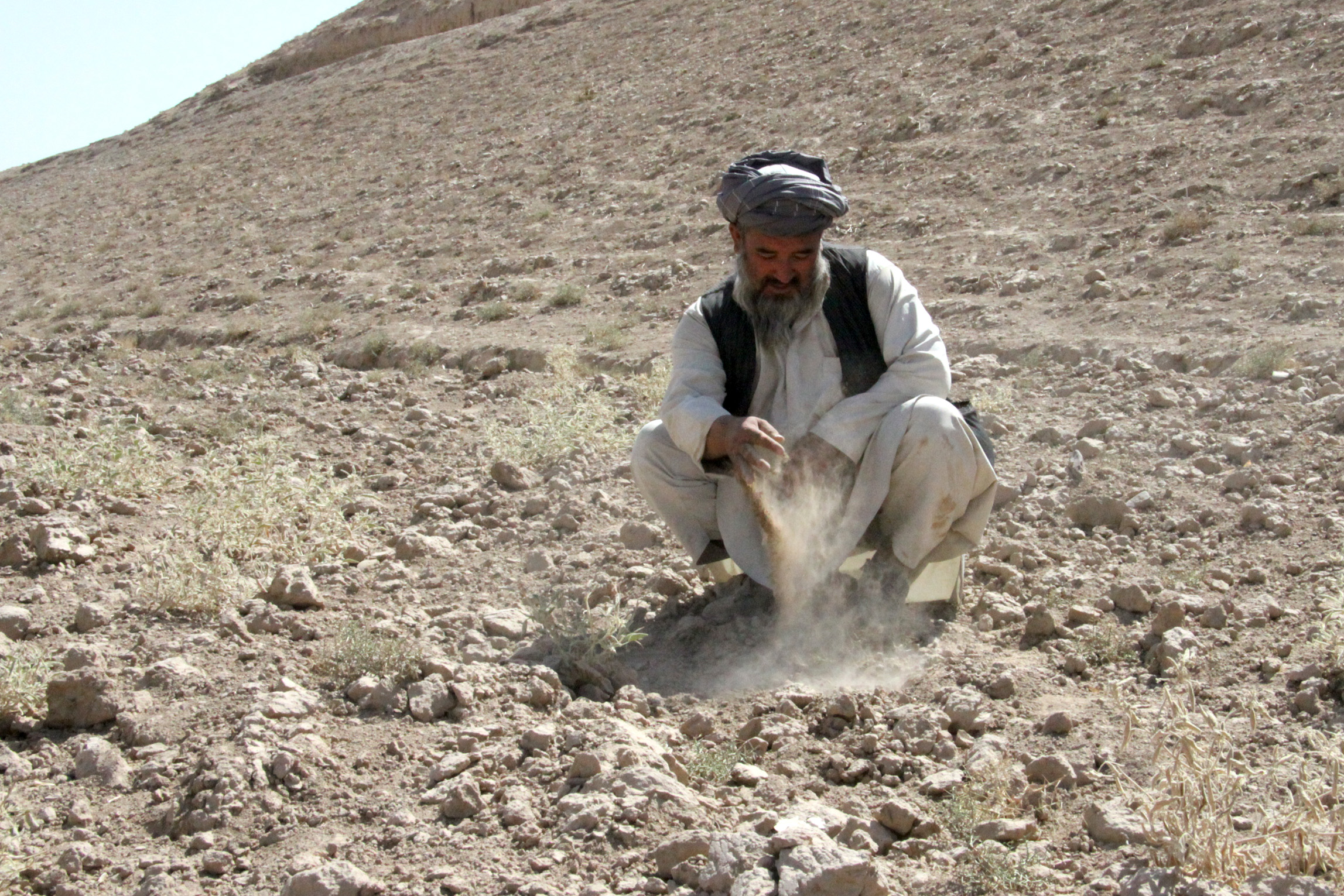 Mohammad Israyel on the hill on which his farm was located in Khuram Sar Bagh, Afghanistan