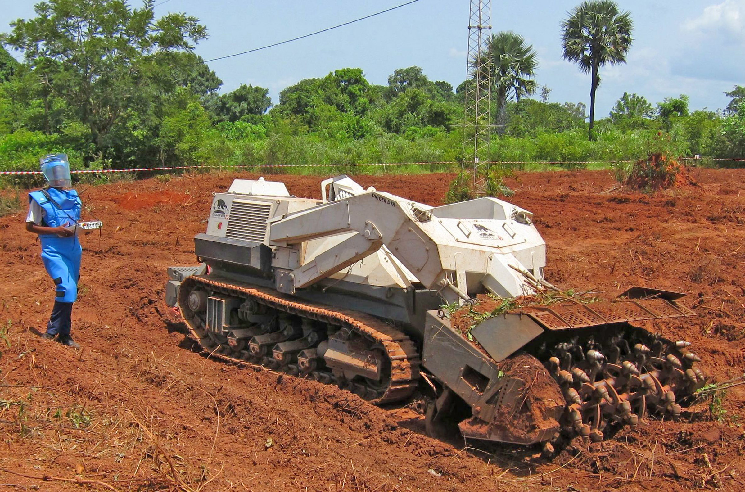 Maibata Sana demonstrates the Digger D-3 demining machine in Sindone, Casamance, Senegal