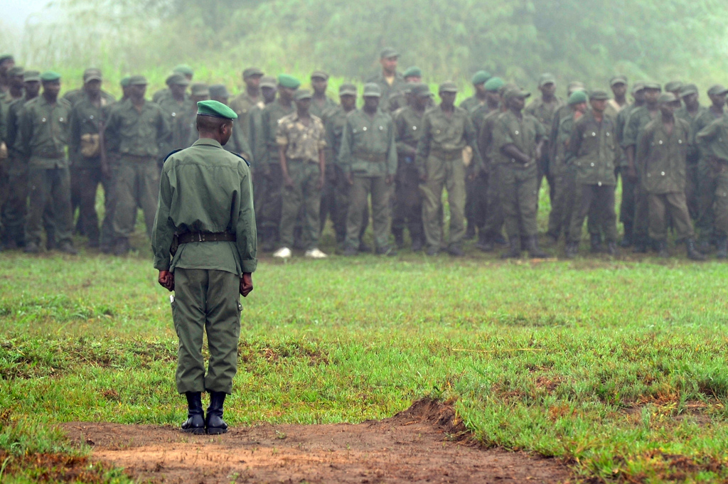 Democratic Republic of Congo Army Forces 2nd Lt. Mukamba-Mongombe, Congolese Light Infantry Battalion duty officer, addresses the battalion in preparation for the flag ceremony on Camp Base, Kisingani, DRC