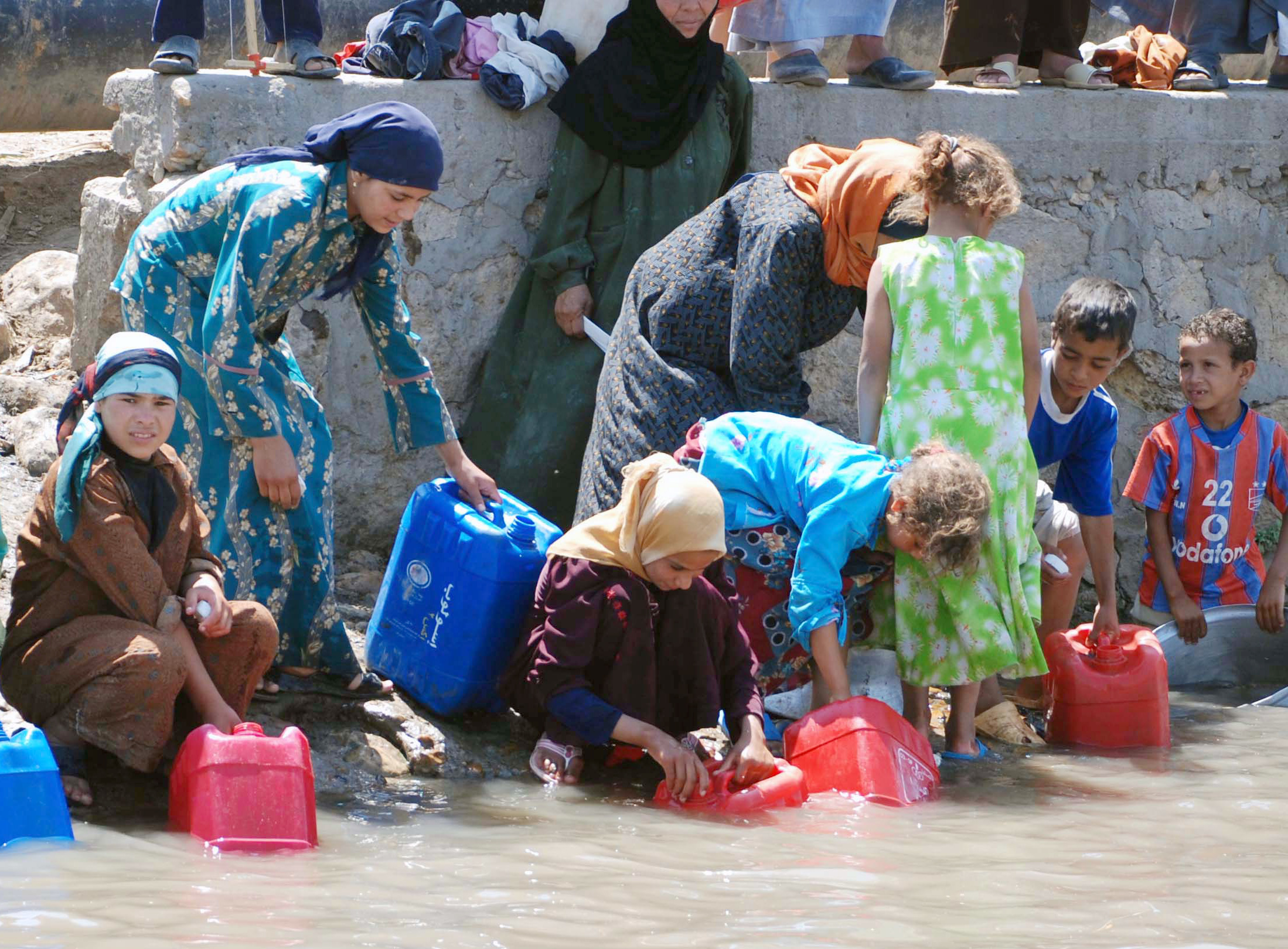 Egyptians fetching water. Water scarcity has already become a fact of daily life for Egyptians