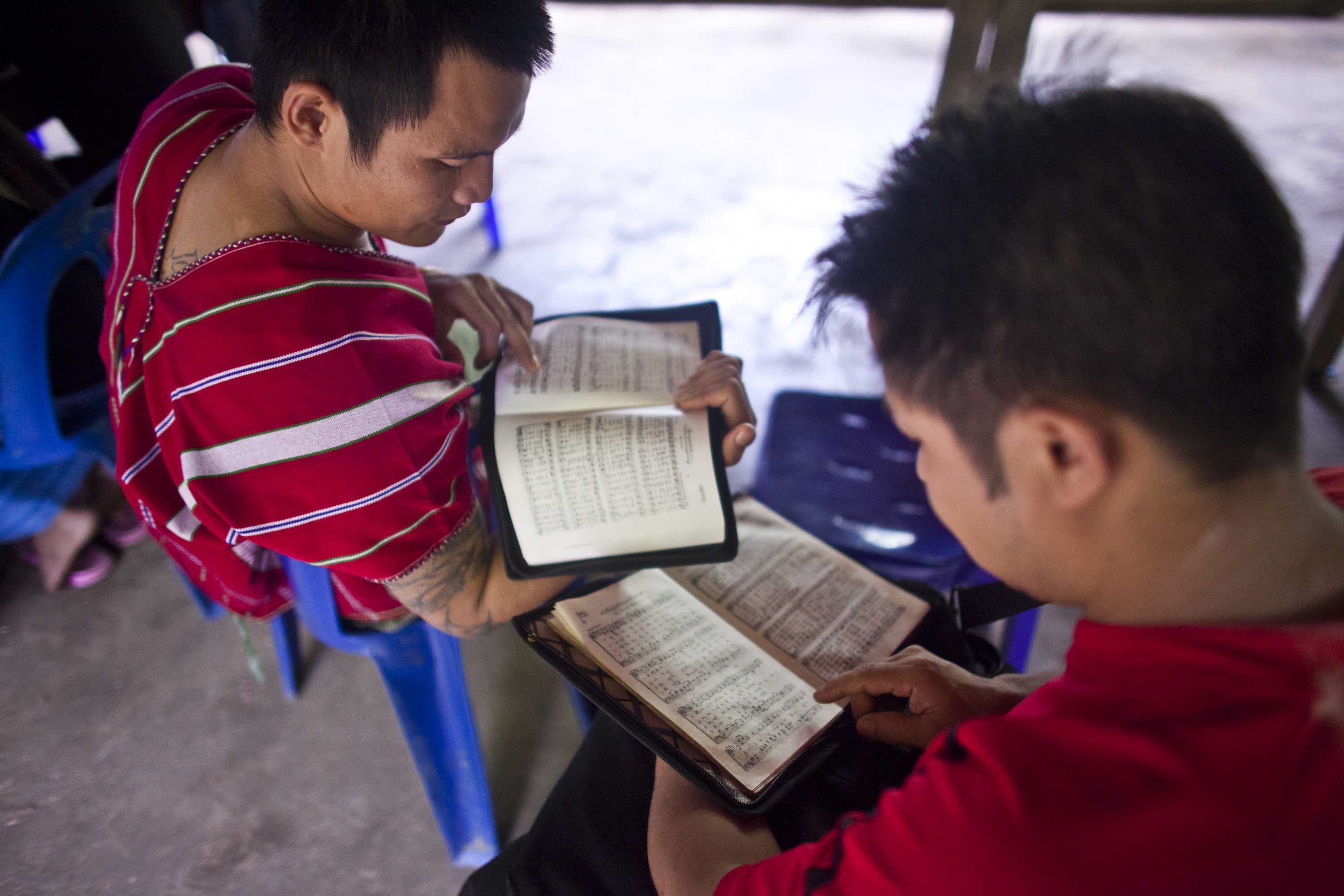 Ethnic Karen refugee students study for an test at Mae La refugee camp along the Thai-Myanmar border. As refugees search for third country sponsors, the brightest and best equipped are usually the first to leave