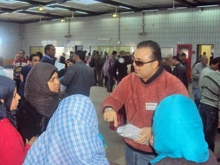 Civil society activist Maged Adeeb distributes information and talks to women about the importance of their political participation in the new Egypt. October 2011