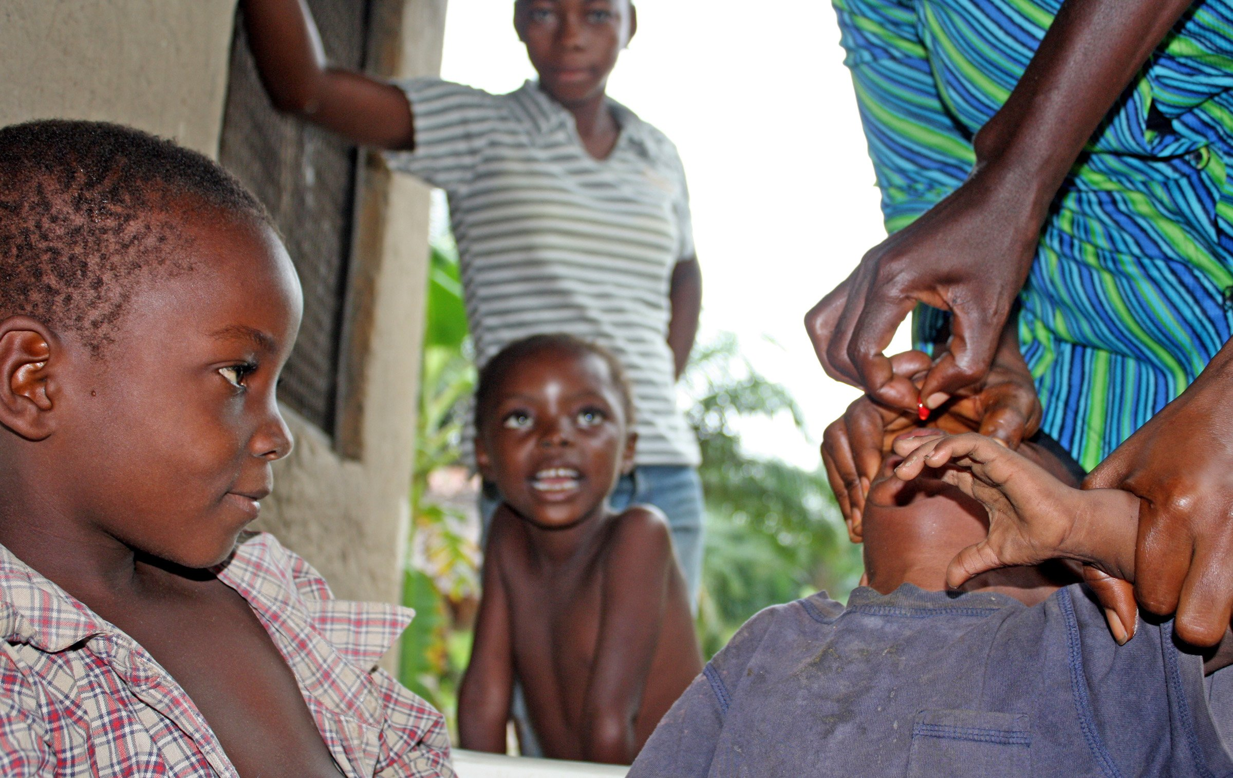 A child is immunized in Mbandaka, Equateur province of the Democratic Republic of Congo, on 21 October 2011. A three-day (20-23 October) vaccination campaign in the country targeted 14 million children aged under five years