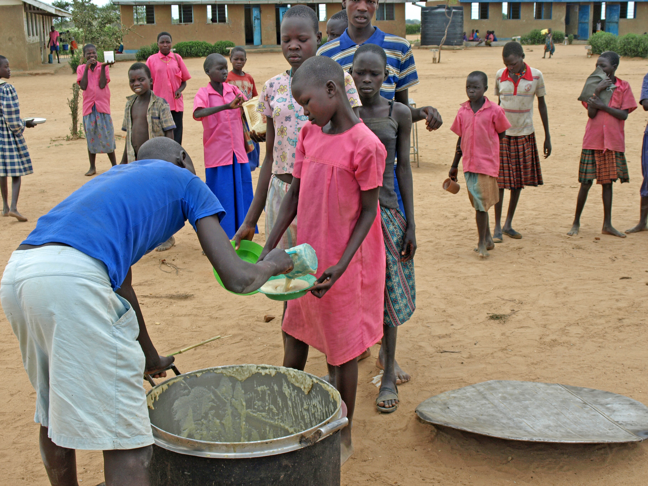 Mealtime at Lopuyo Primary School in Kotido District, in Uganda's eastern Karamoja region. Rations have recently been reduced due to a funding gap at WFP. Combined with the increased demand for labour during the current harvest period, this has reduced