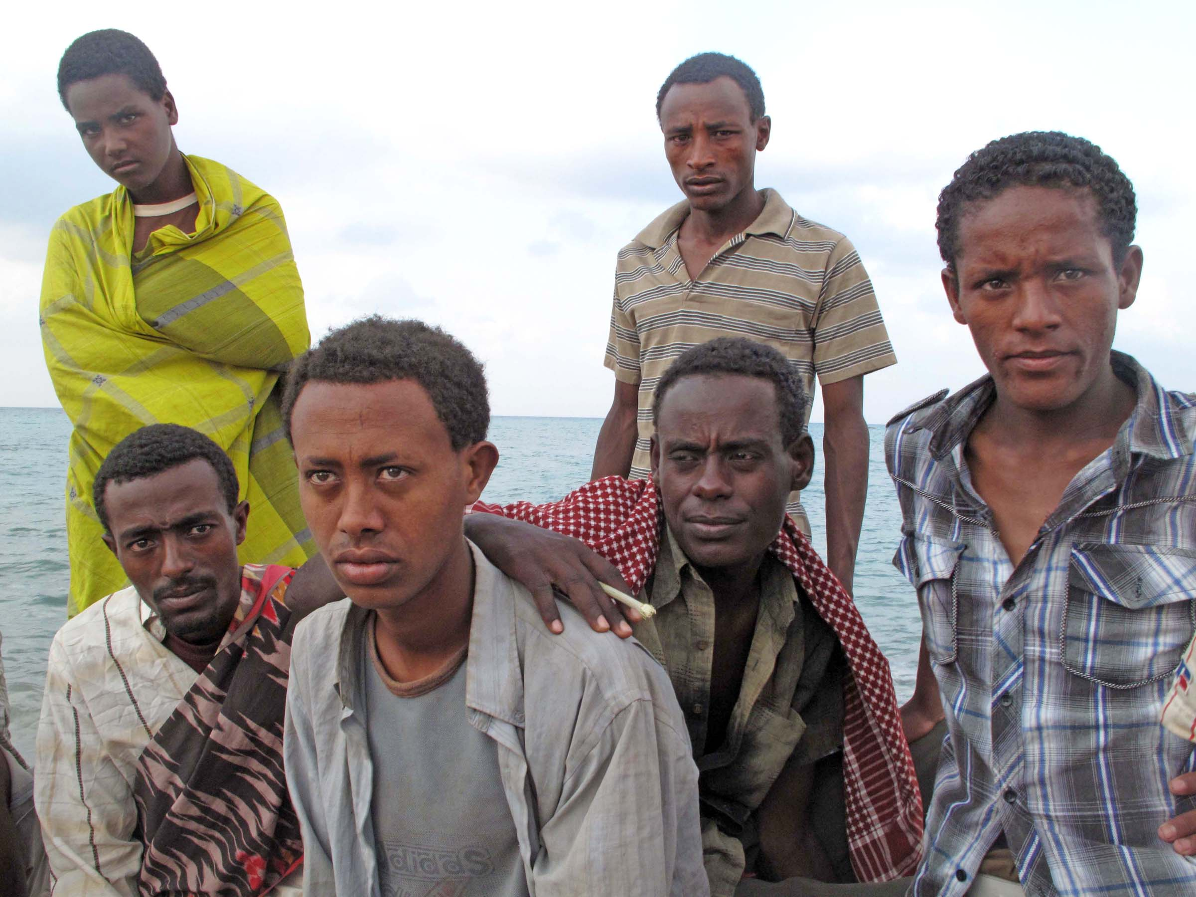 Some of the Ethiopian migrants gathered on Obock's pier have been stranded in the town for over a month after smugglers promised them passage to Yemen and then disappeared with their money