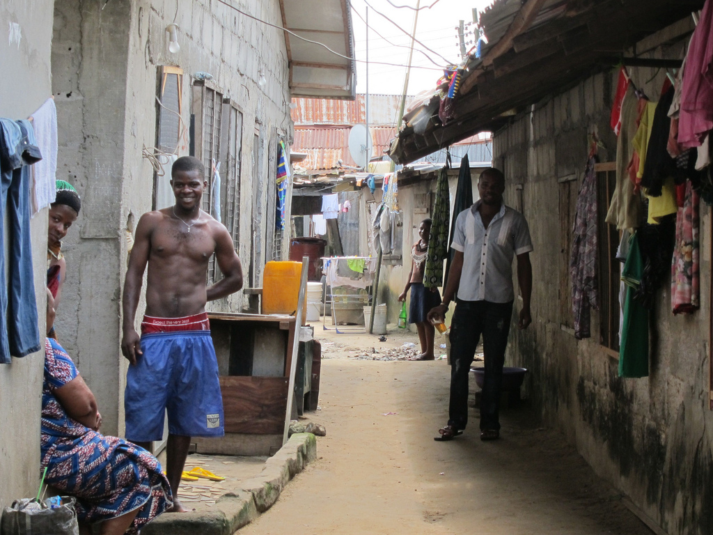 Locals in the narrow streets of the Igbikisikala-Ama settlement in Port Harcourt's waterfront shantytowns