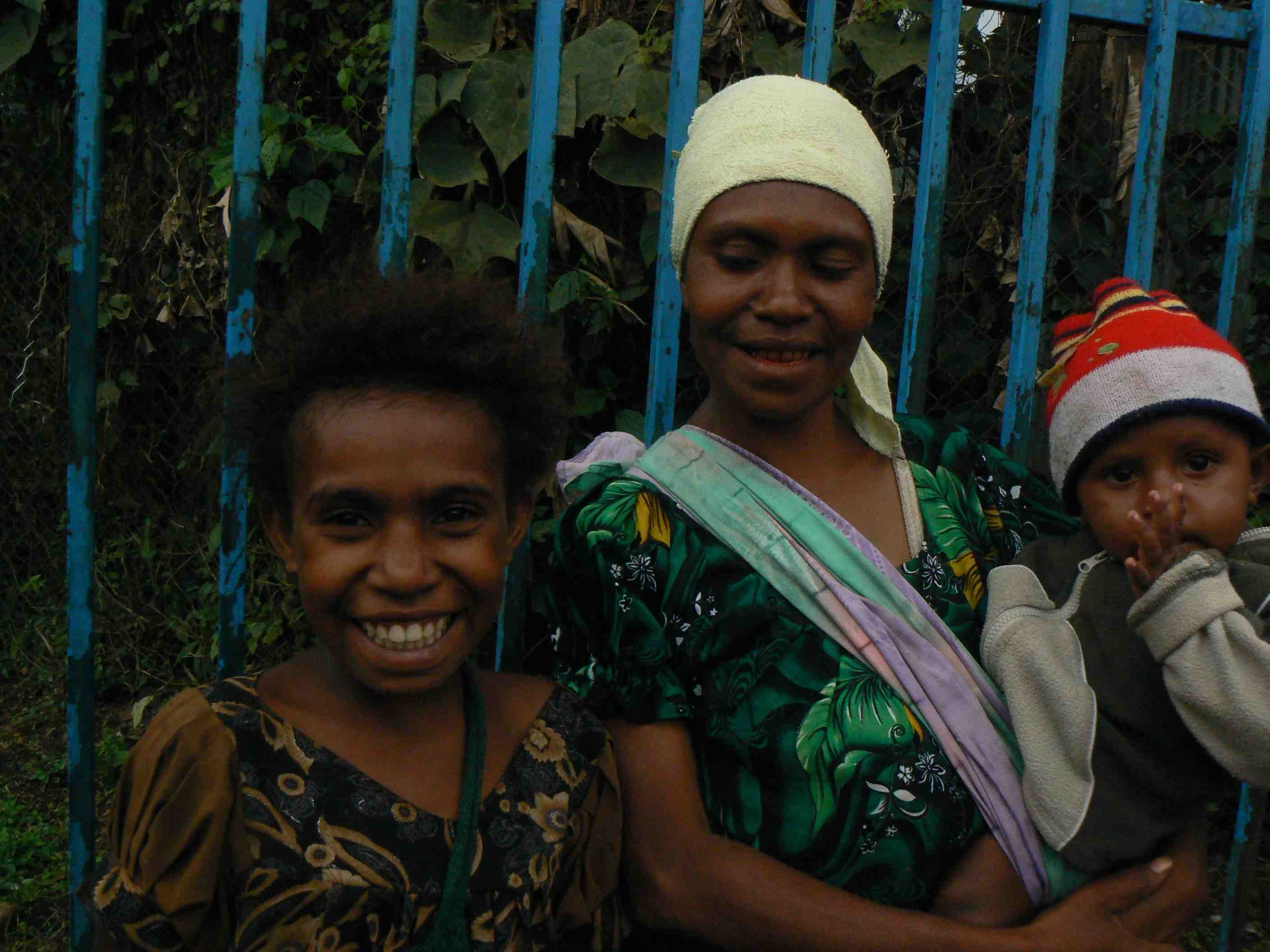 PNG's maternal mortality rate has stayed persistently high in part due to early pregnancies. Lisa Micheals, 27, is pictured with two of her five children she started having at age 16. She decided to have a tubal ligation after her most recent one after wa